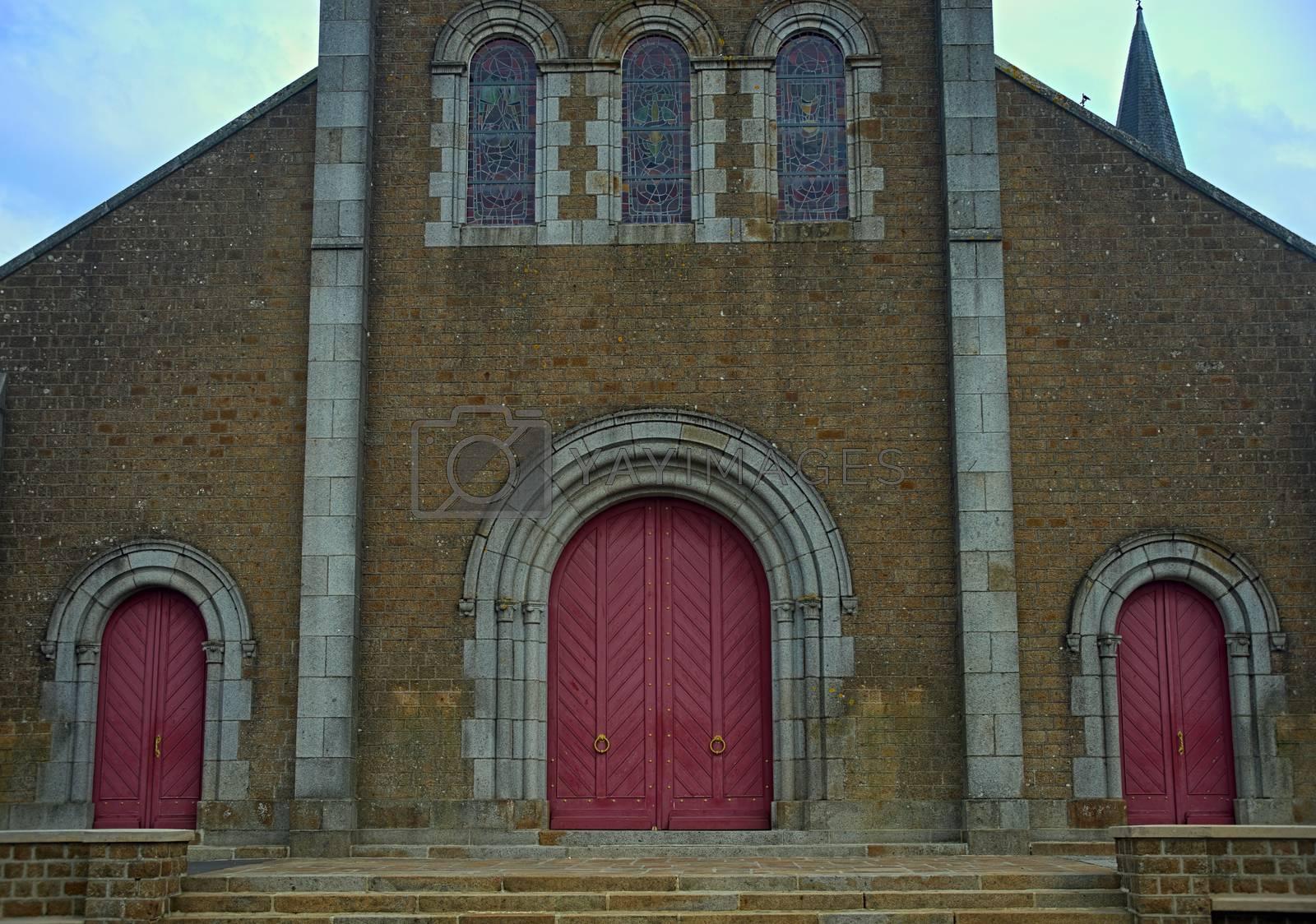 Royalty free image of Main front entrance at big old stone catholic cathedral by sheriffkule