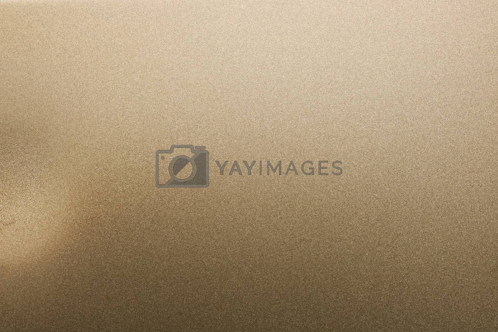 Royalty free image of Dirty on brushed bronze metal plate, abstract texture background by mouu007