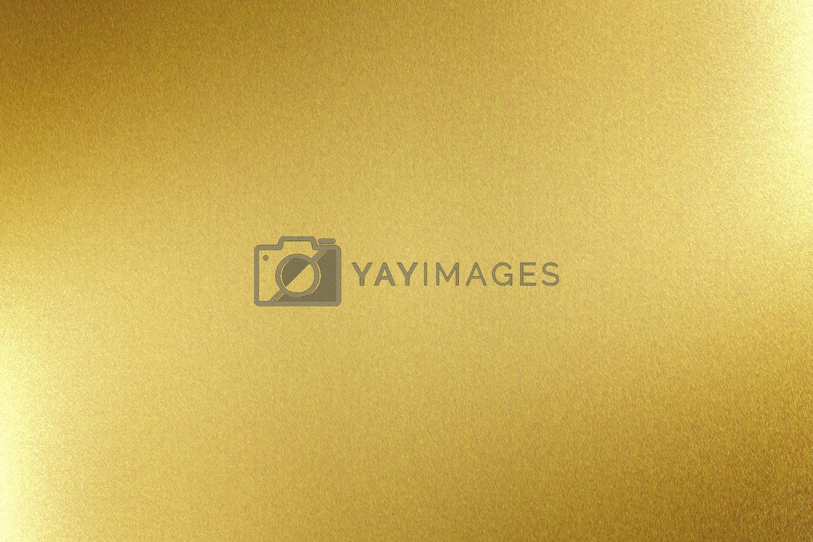 Royalty free image of Light shining on gold metal board, abstract texture background by mouu007