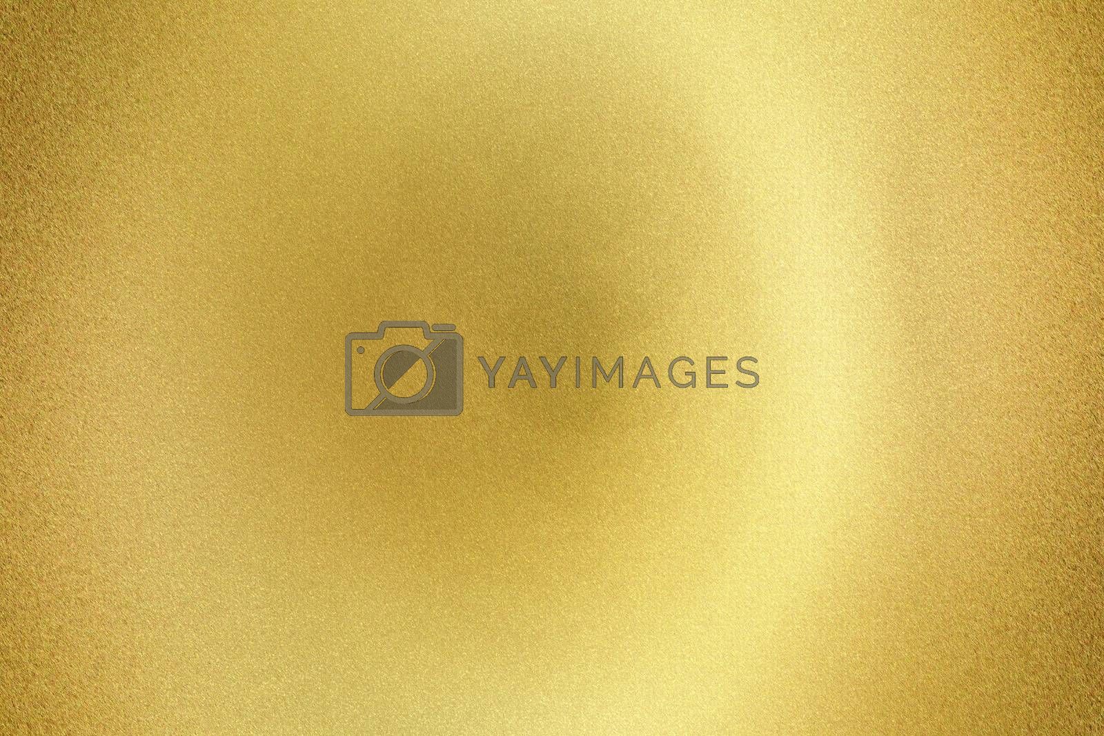 Royalty free image of Light shining on gold rough metal sheet board , abstract texture background by mouu007