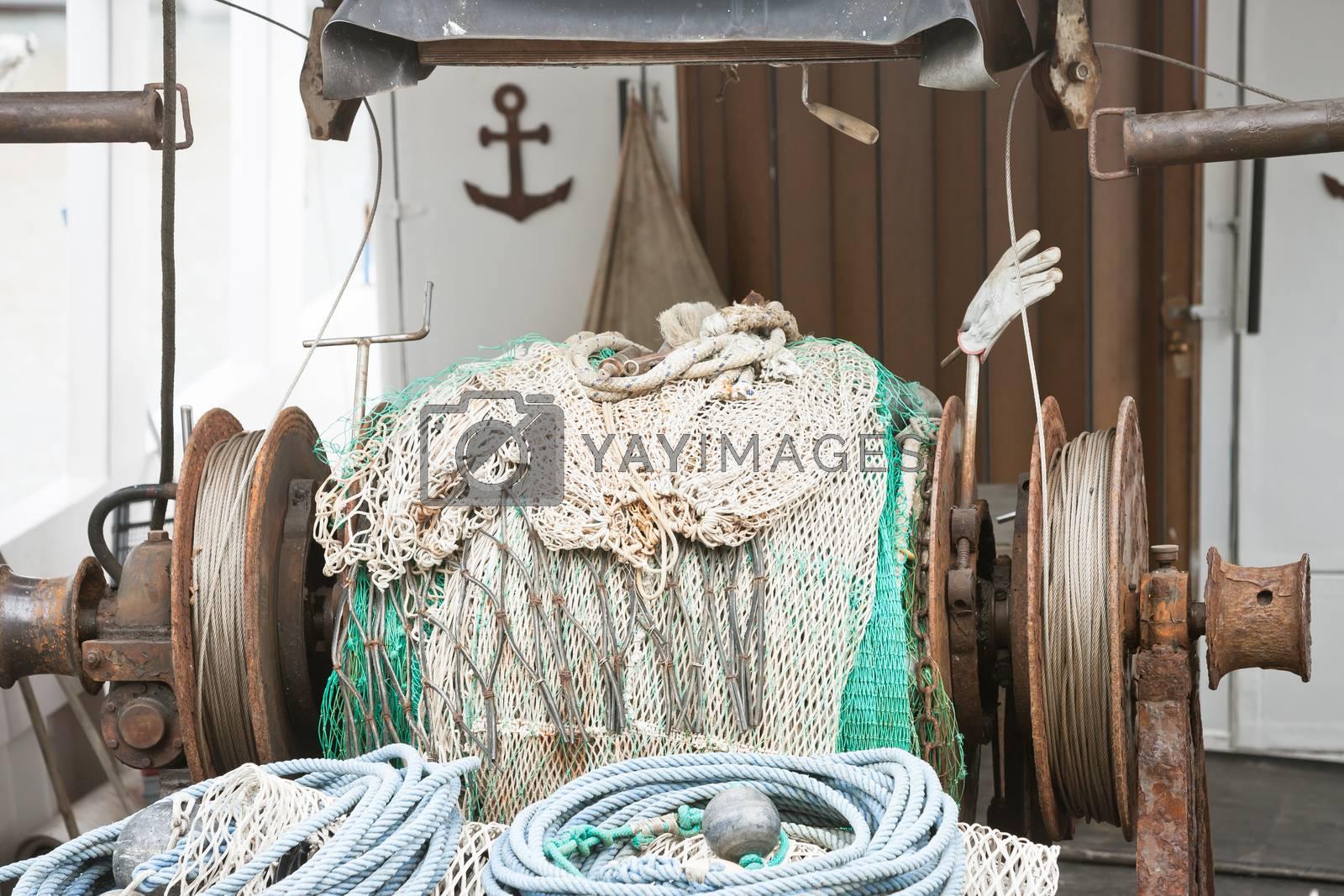 Novigrad, Istria, Croatia, Europe - An old fishing net winch on a fishing boat