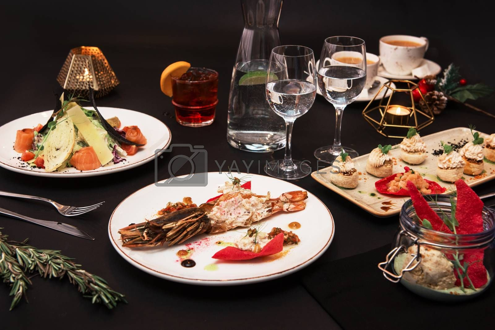Tasty restaurant dishes: Cooked and stuffed crayfish, salad, appetizers, and crayfish ice-cream
