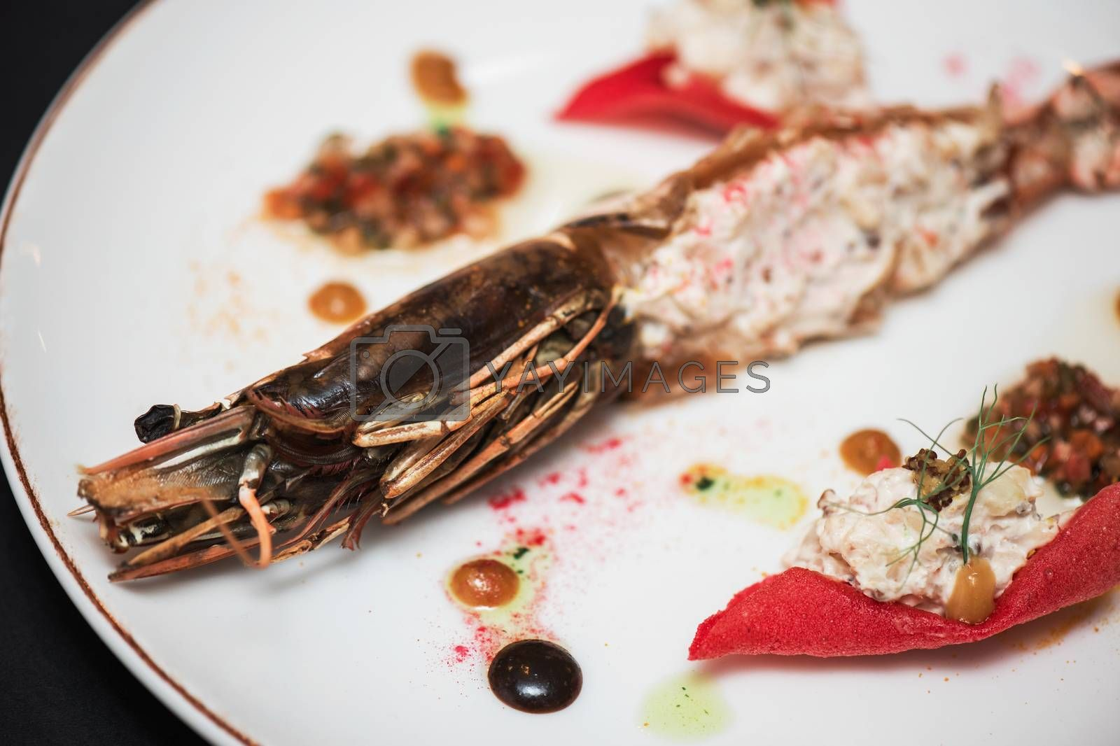 Cooked and stuffed crayfish on the table. Tasty restaurant dish