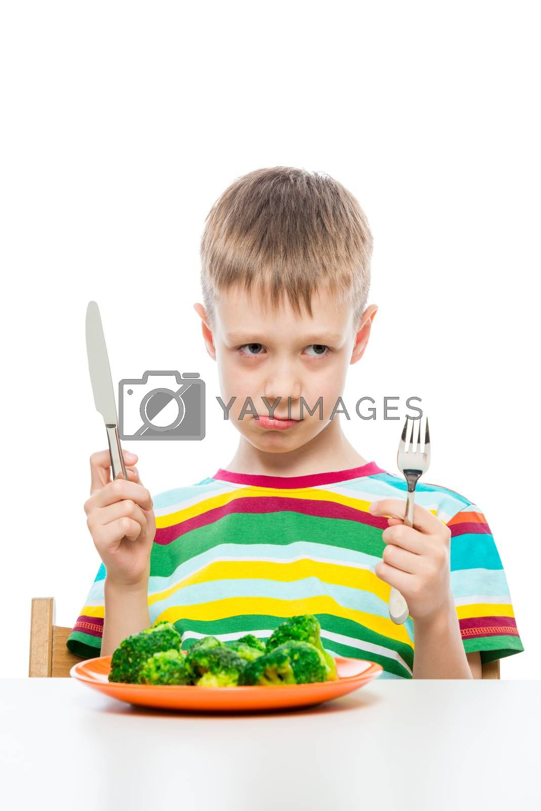 The boy with the unloved food broccoli on a white background
