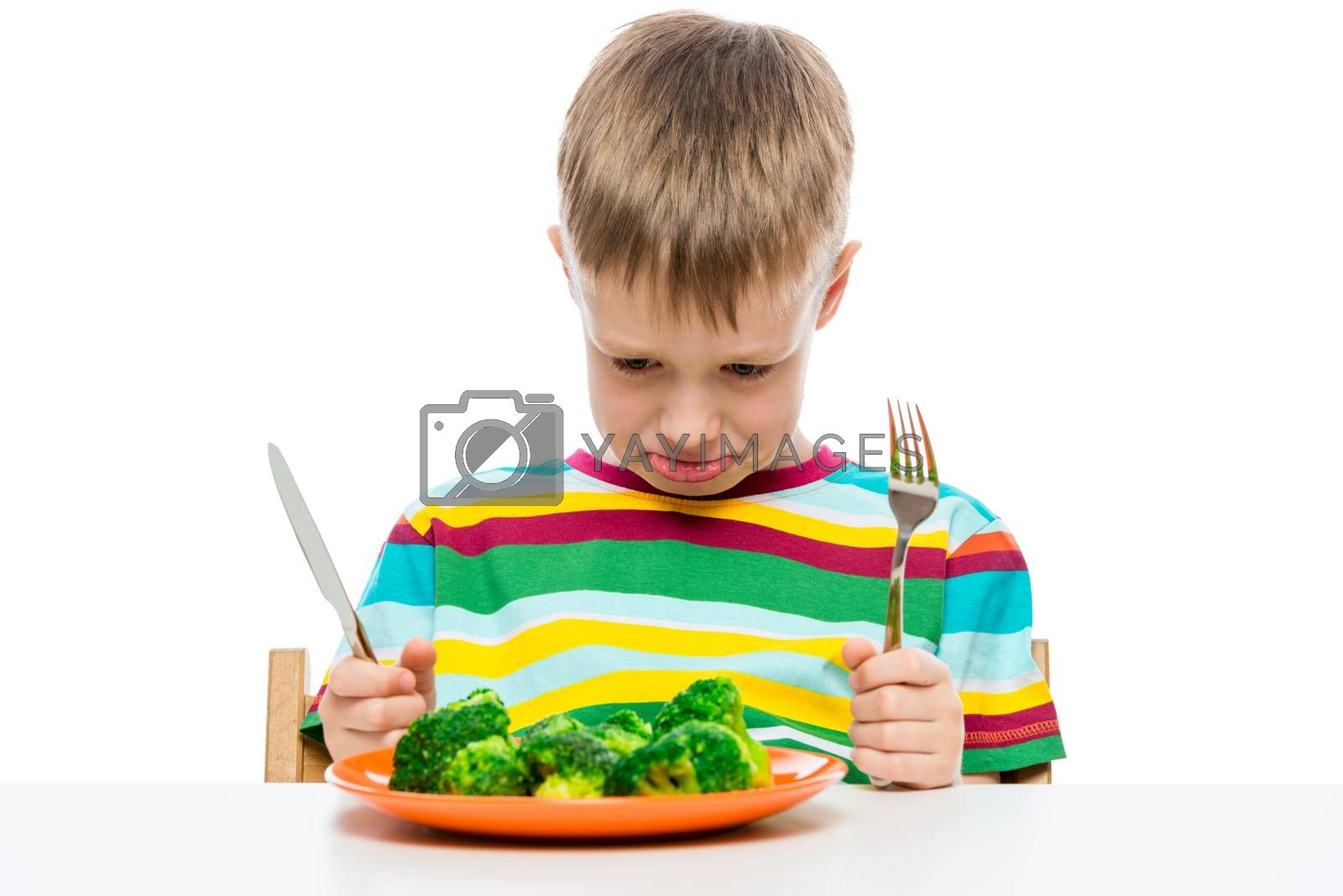 emotional portrait of a boy who doesn't like to eat broccoli, shooting in the studio