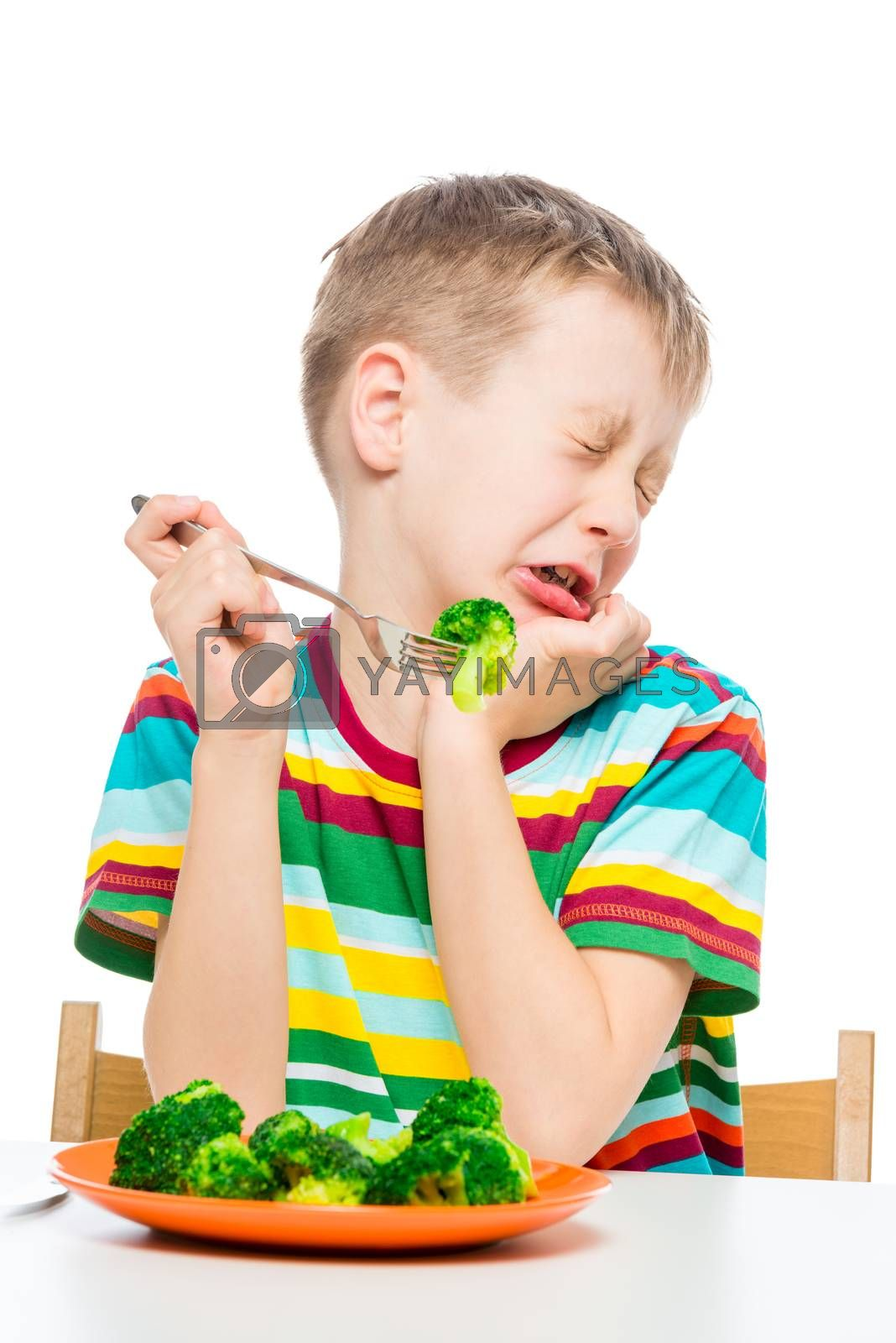 Emotional portrait of a child who does not like broccoli, the portrait is isolated