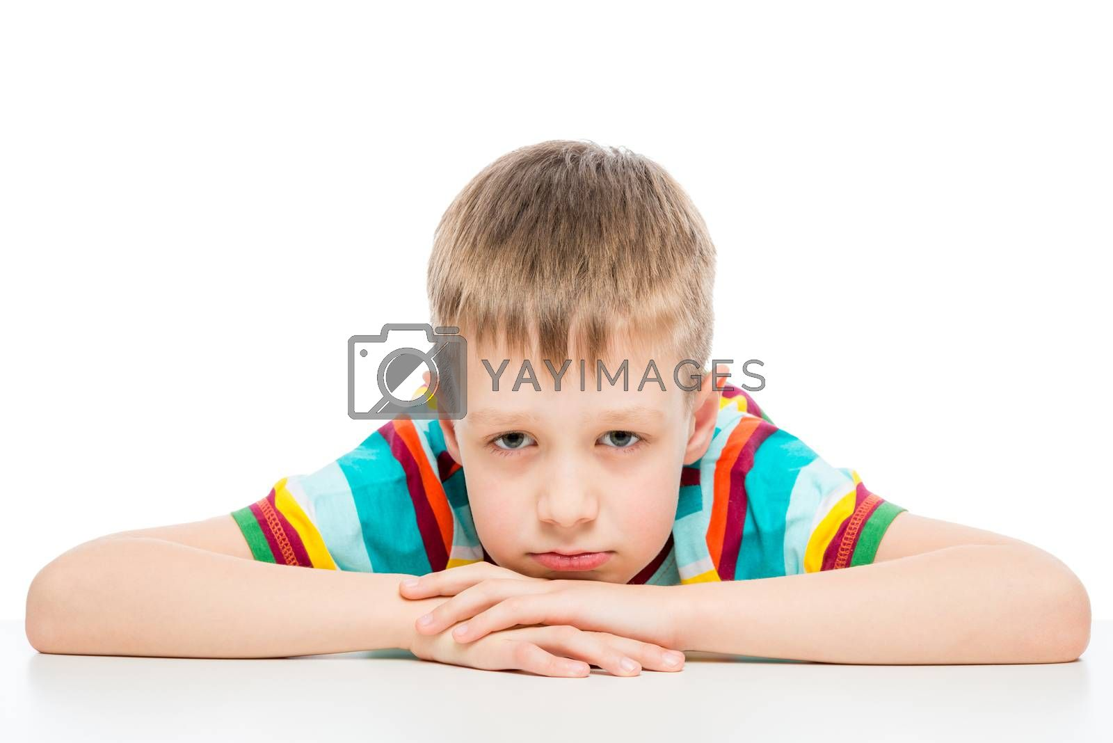 portrait of a sad boy of 10 years on white background isolated