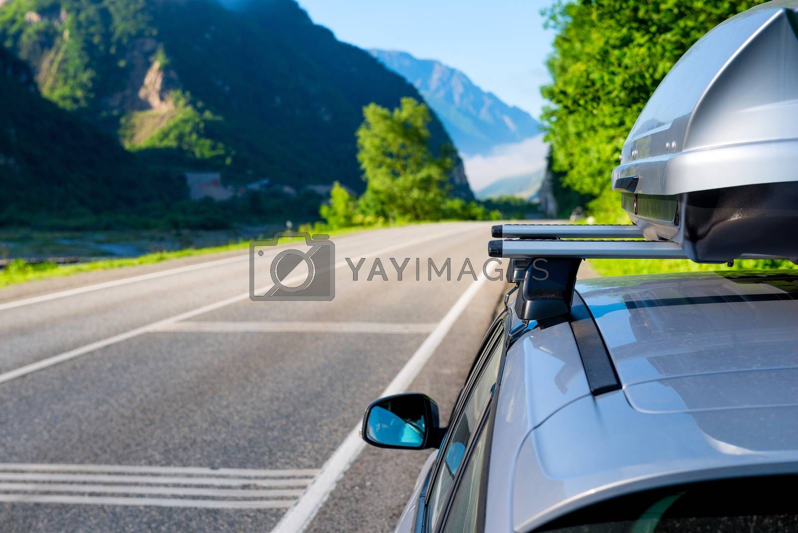 Royalty free image of Picturesque mountains and the canyon of the Caucasus and the car by kosmsos111