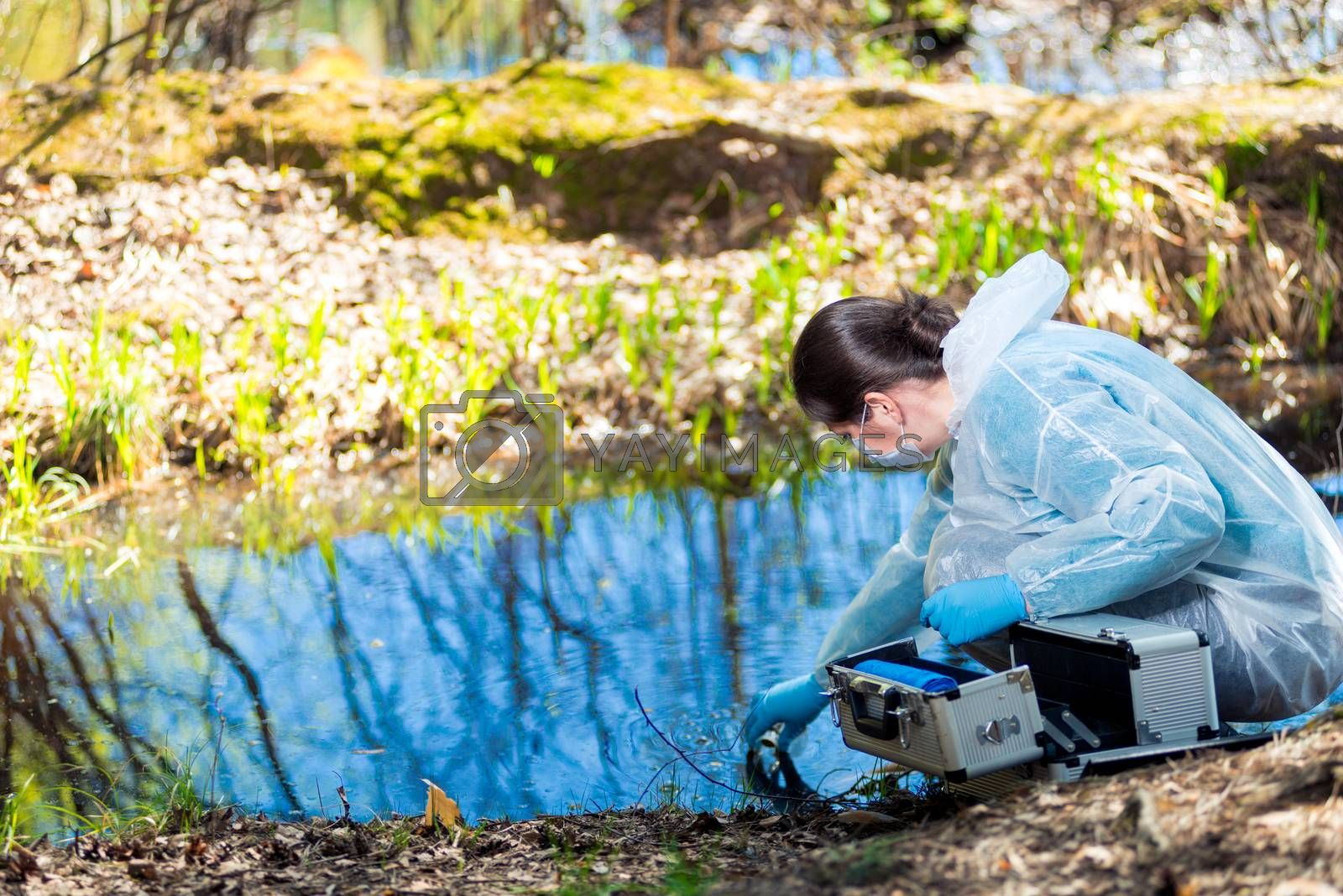 a chemist conducts a study of water from a natural source in the forest, identifying an epidemic