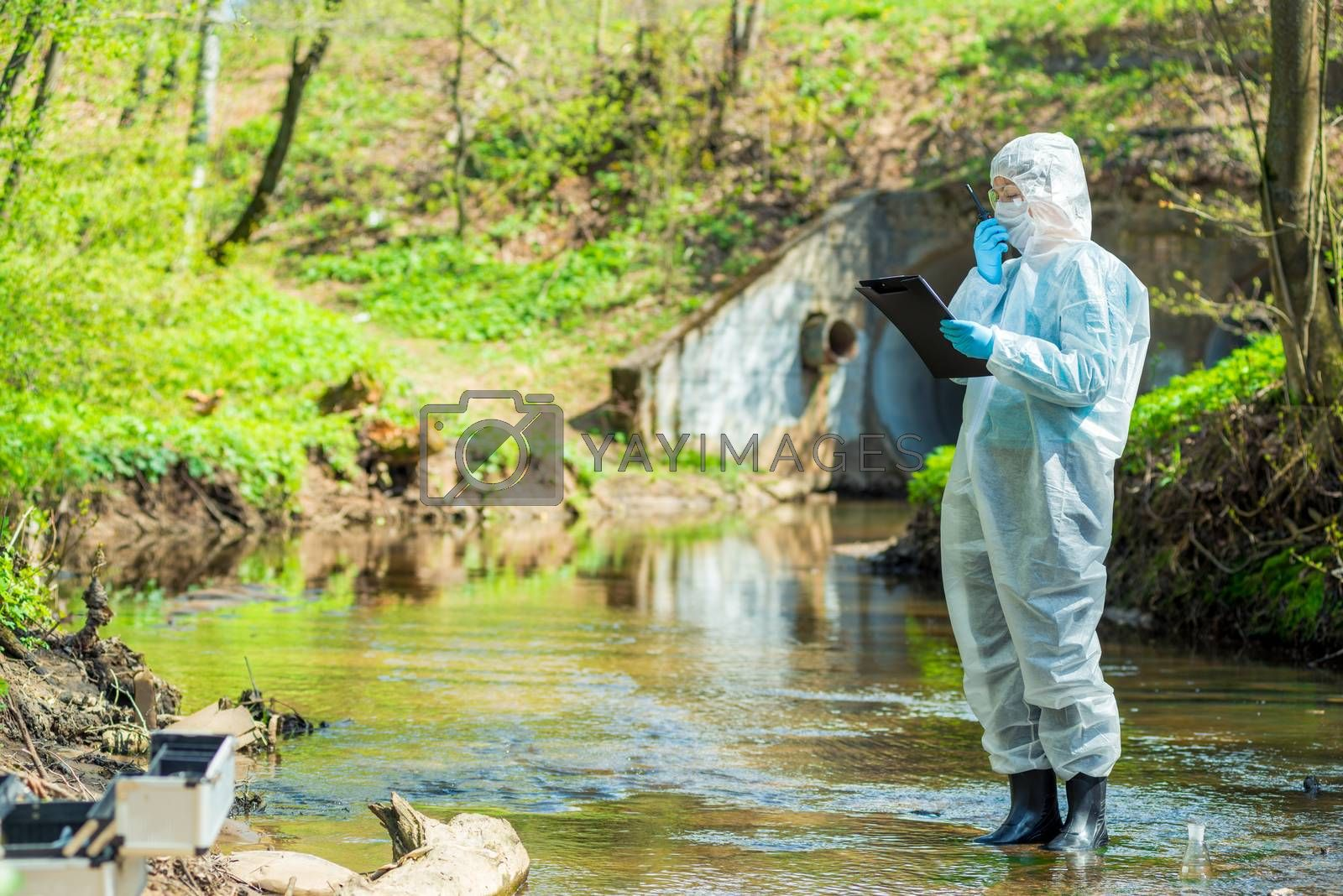 scientist doing research on the environment and water in the sewer creek