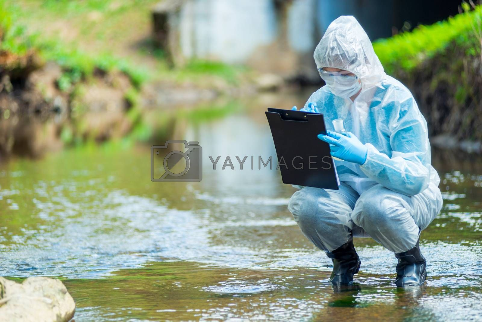 the work of a scientist ecologist, a portrait of an employee who conducts a study of water in a creek