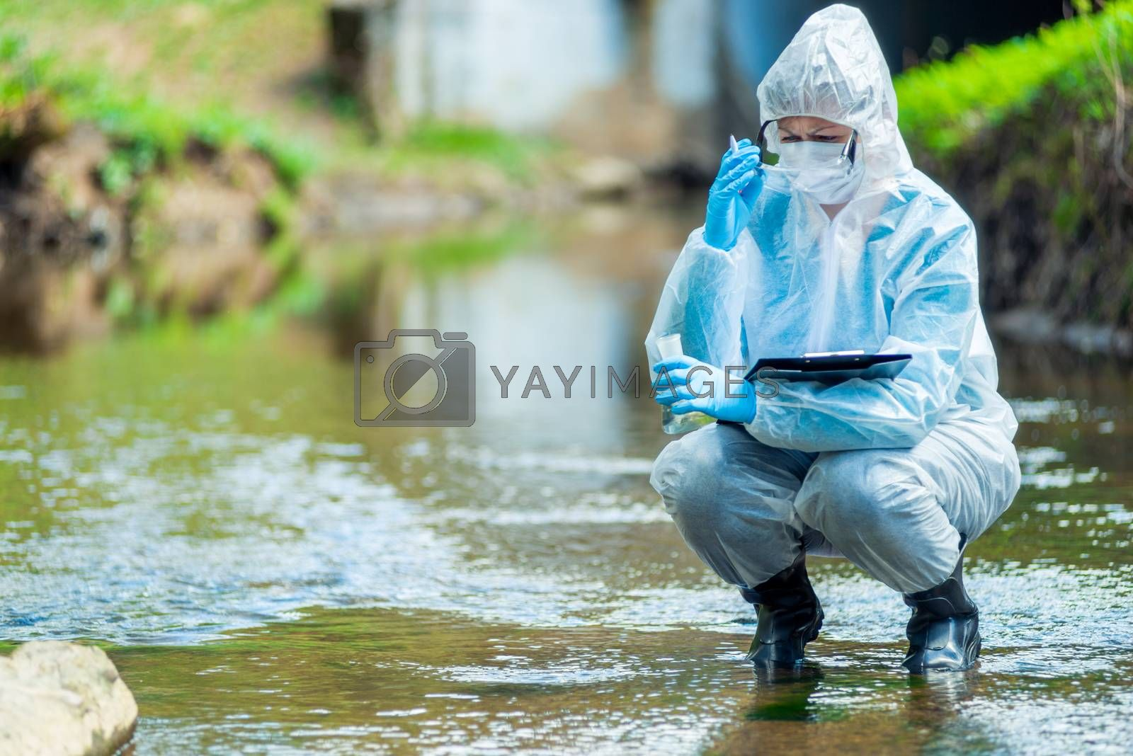 Photos chemist takes water samples