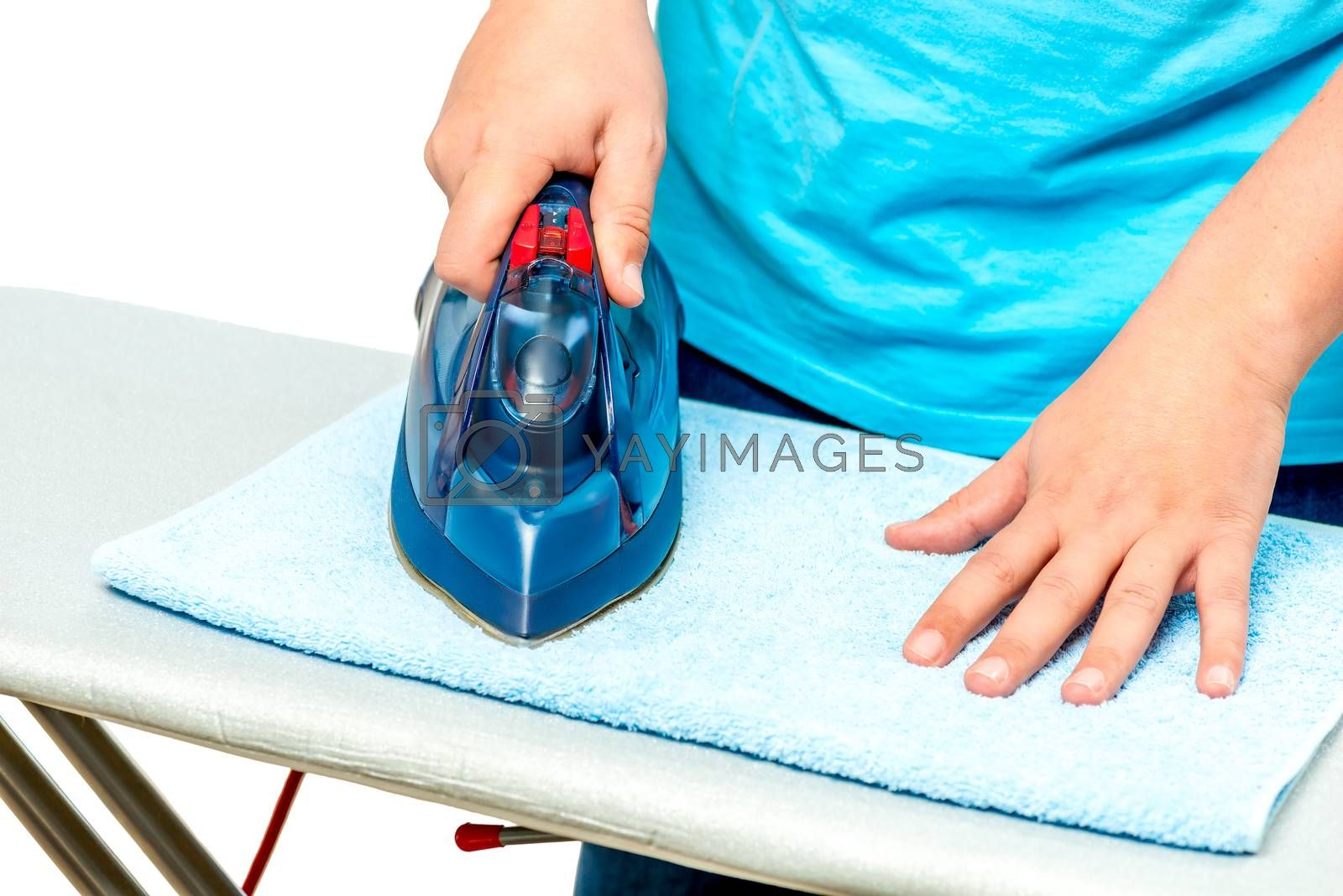closeup of male hands with iron while ironing terry towel