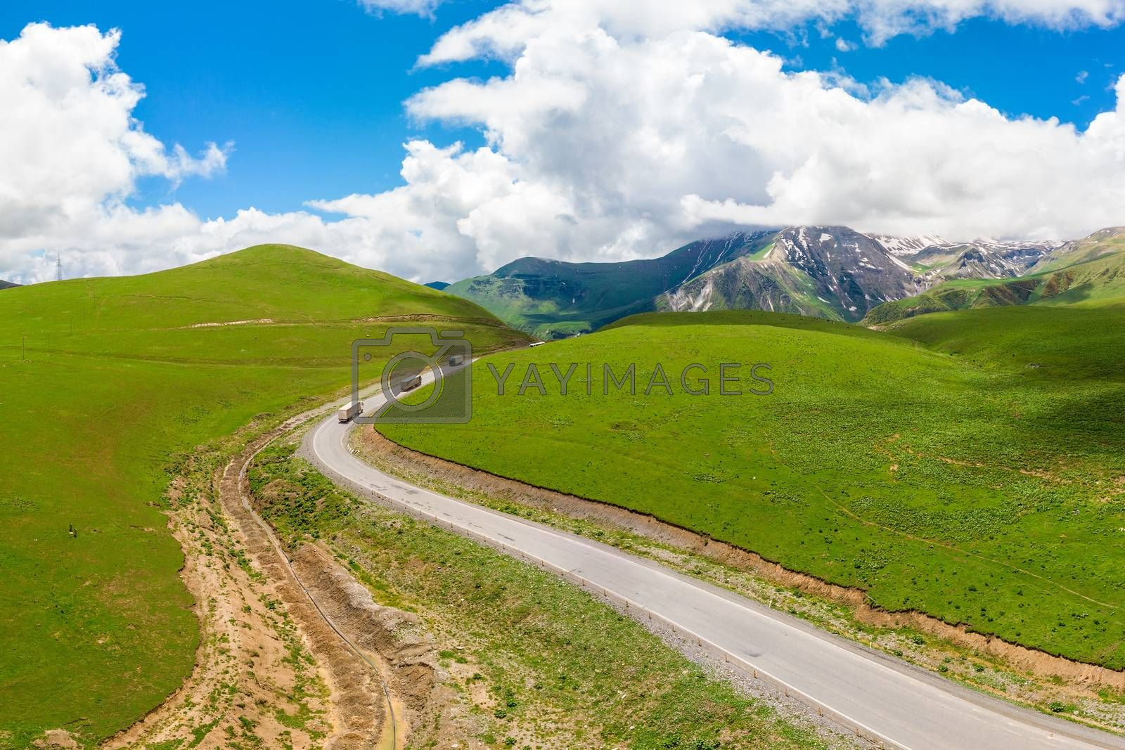 Wagons on a mountain road, scenic landscape from quadrocopter top view
