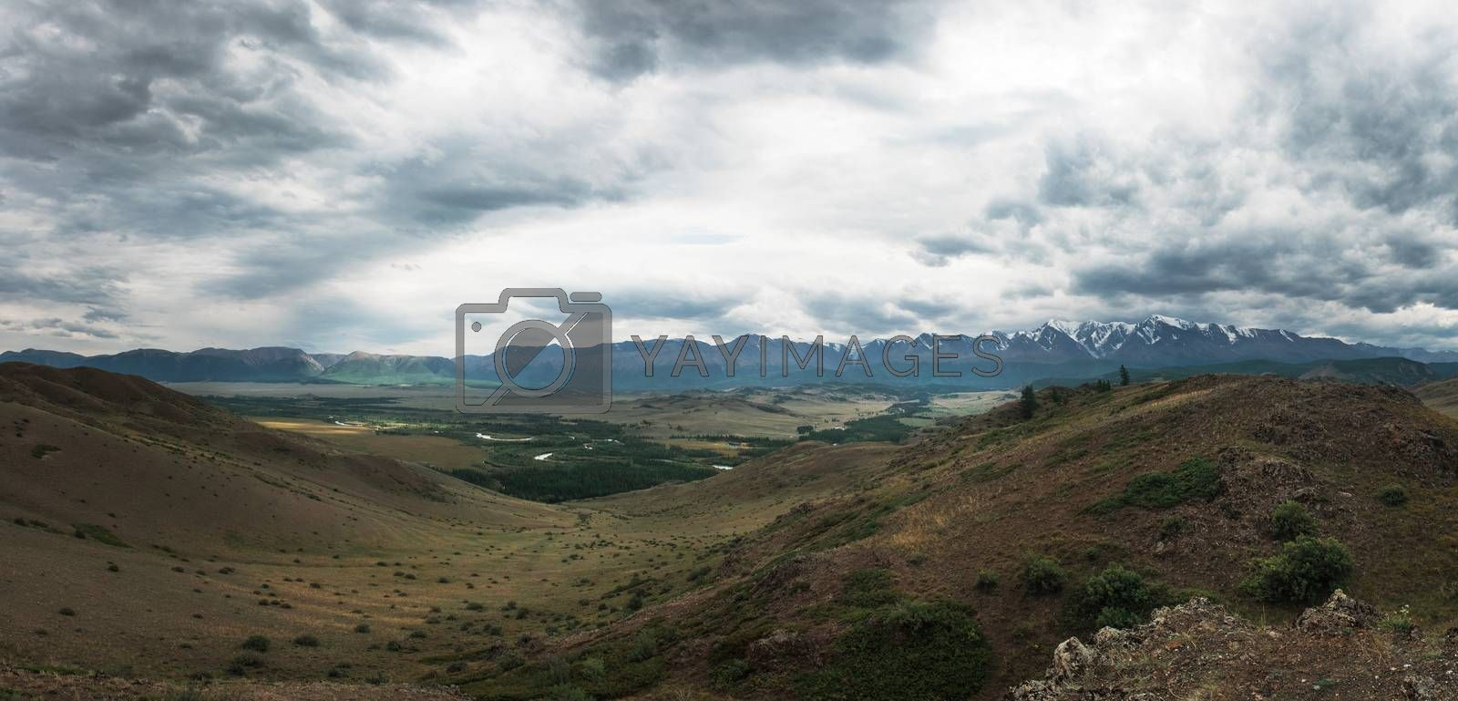Panoramic picture of Kurai steppe and North-Chui ridge of Altai mountains, Russia. Cloud day.