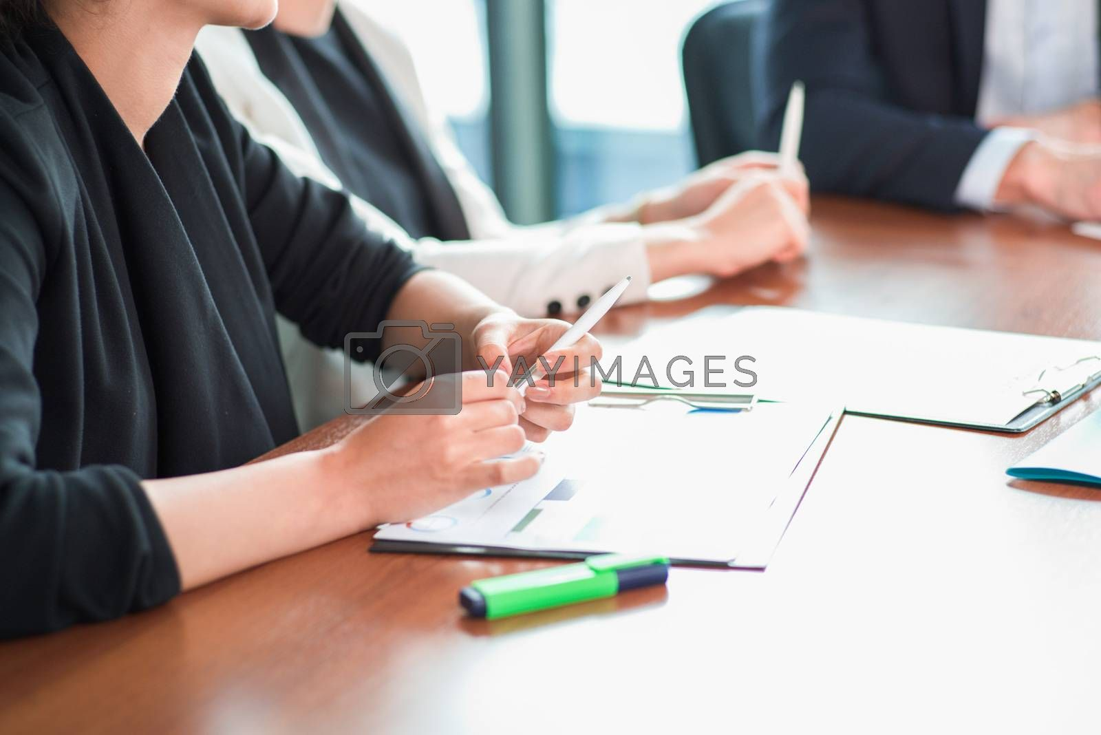 Business people discussing financial reports at meeting table