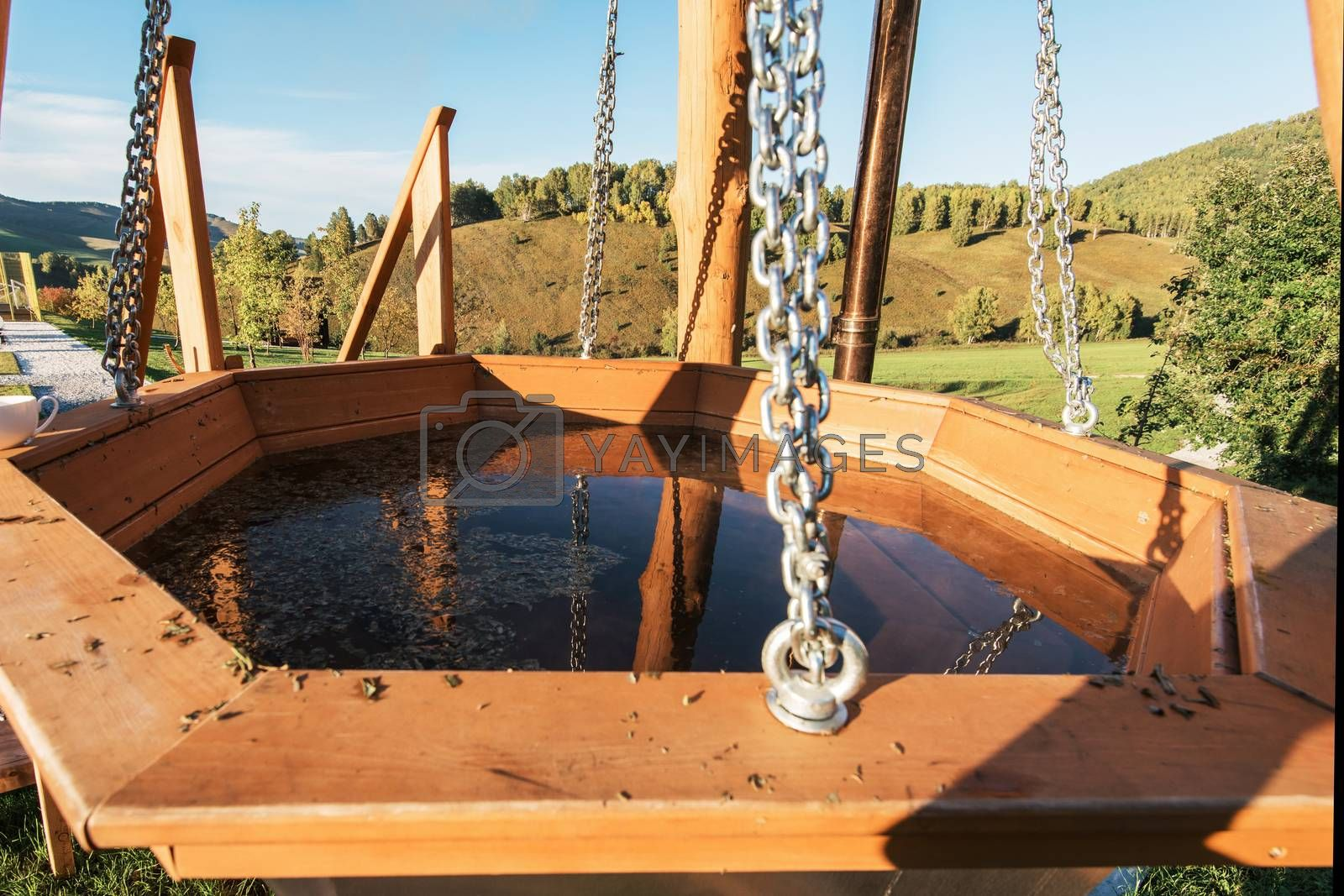 Big vat with hot water and herbs for bathing, spa and relax. Outdoor in Altai mountains, Siberia, Russia