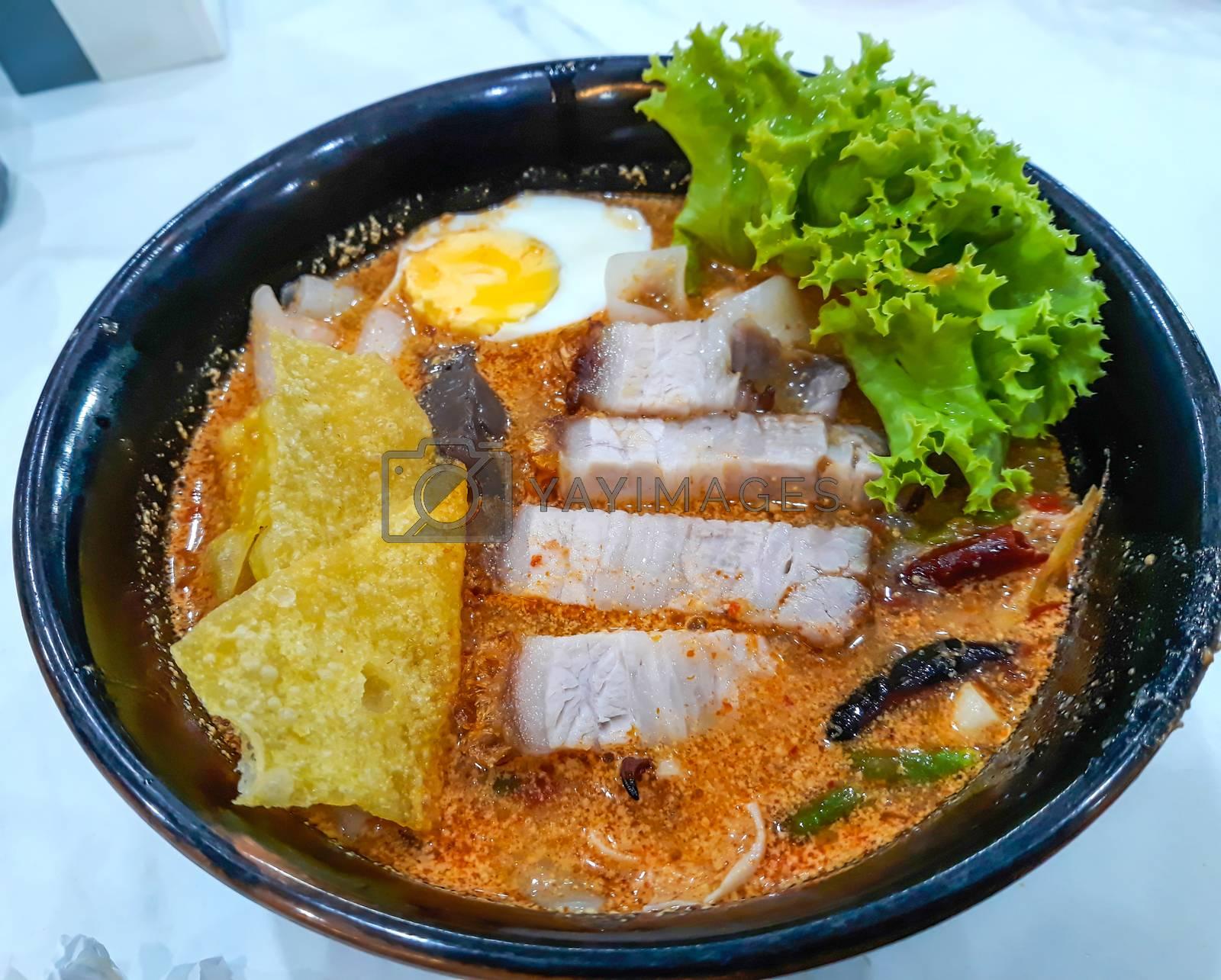 Spicy noodle with  crispy pork ,Thai food. by Nunnicha Supagrit