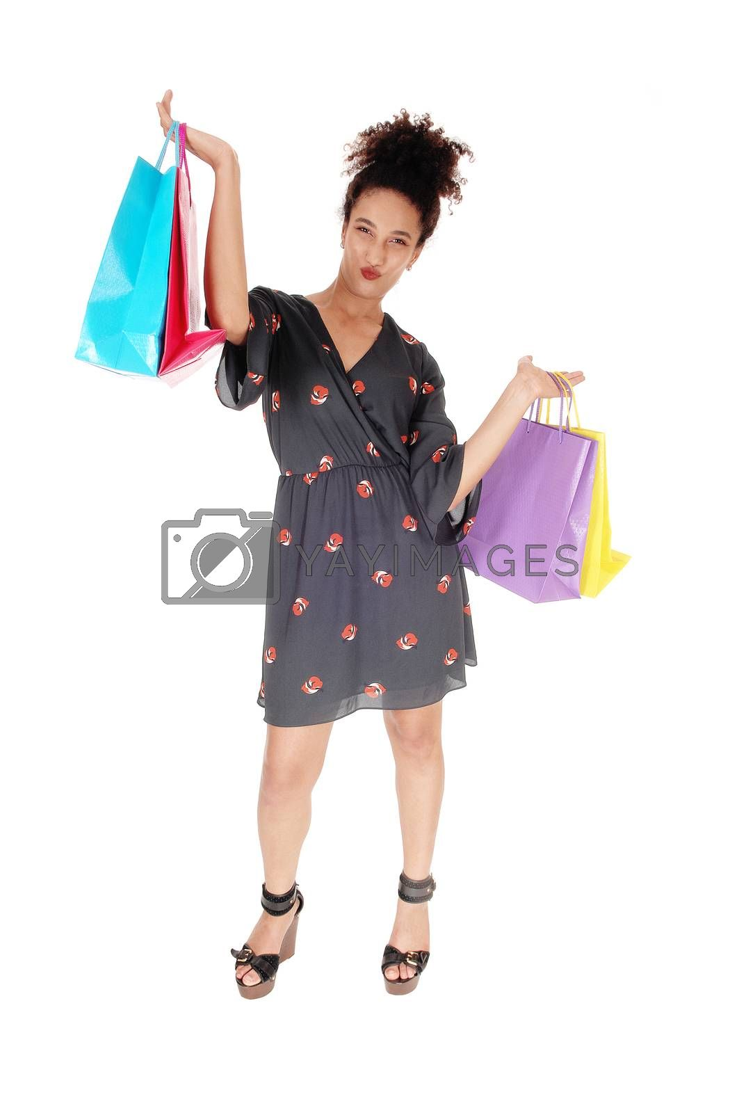 Happy young shopping woman with the bags lifted up by feierabend