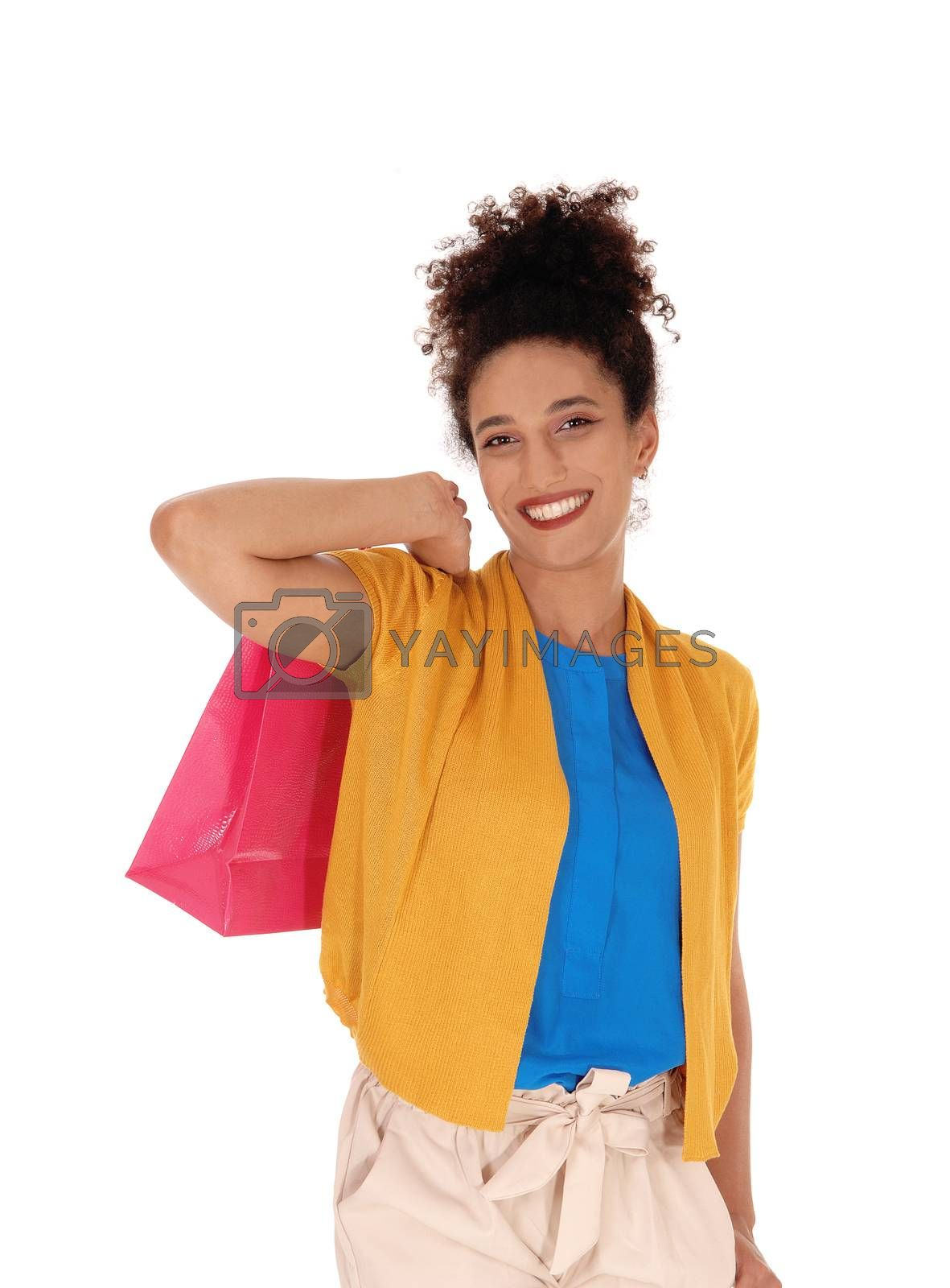 A happy multi-racial woman with her shopping bag by feierabend