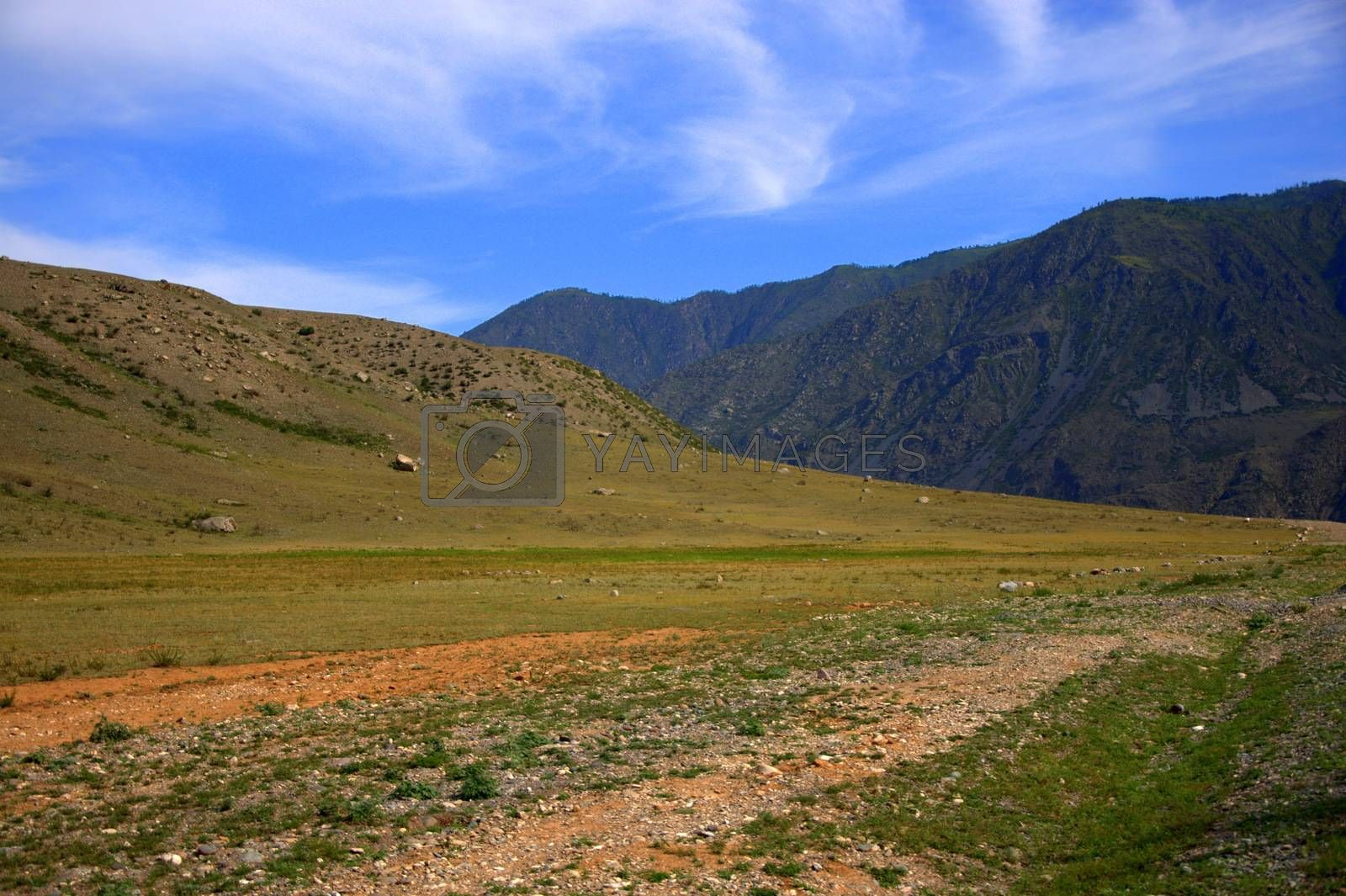 Gravel road surrounded by high gentle mountains. Altai, Siberia, Russia. Landscape. by Alex Yellow