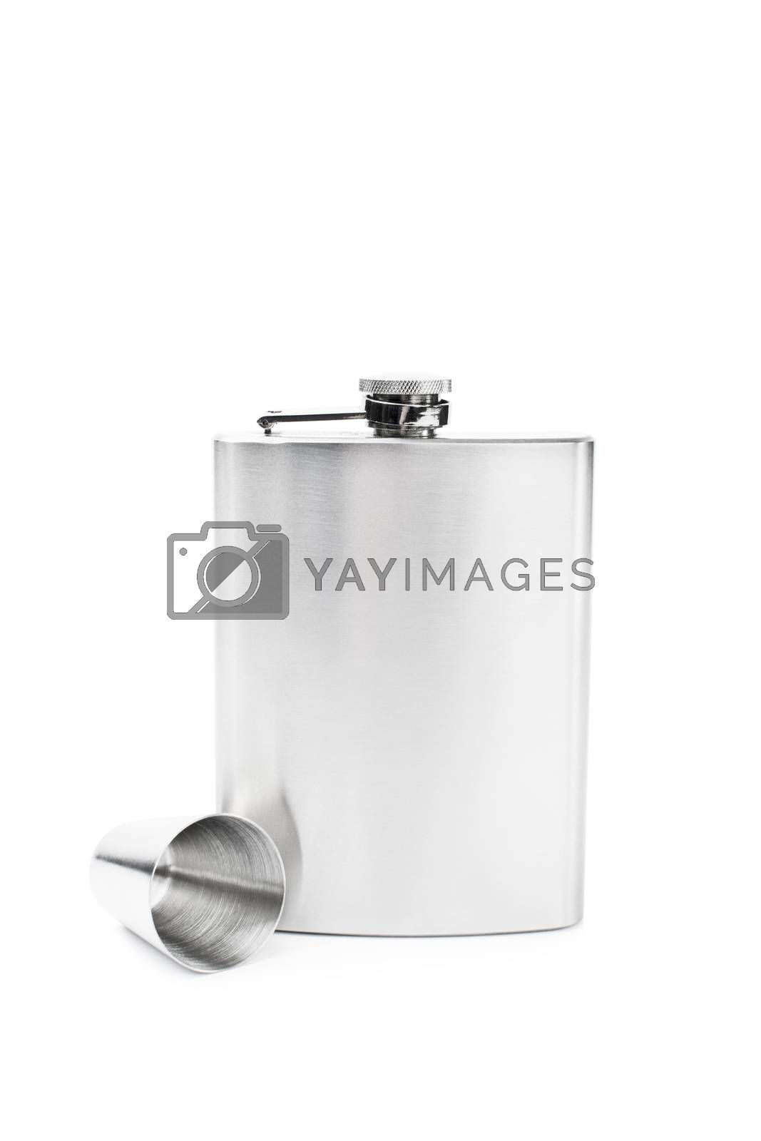 Stainless steel flask with a small metal cup, isolated on white background.