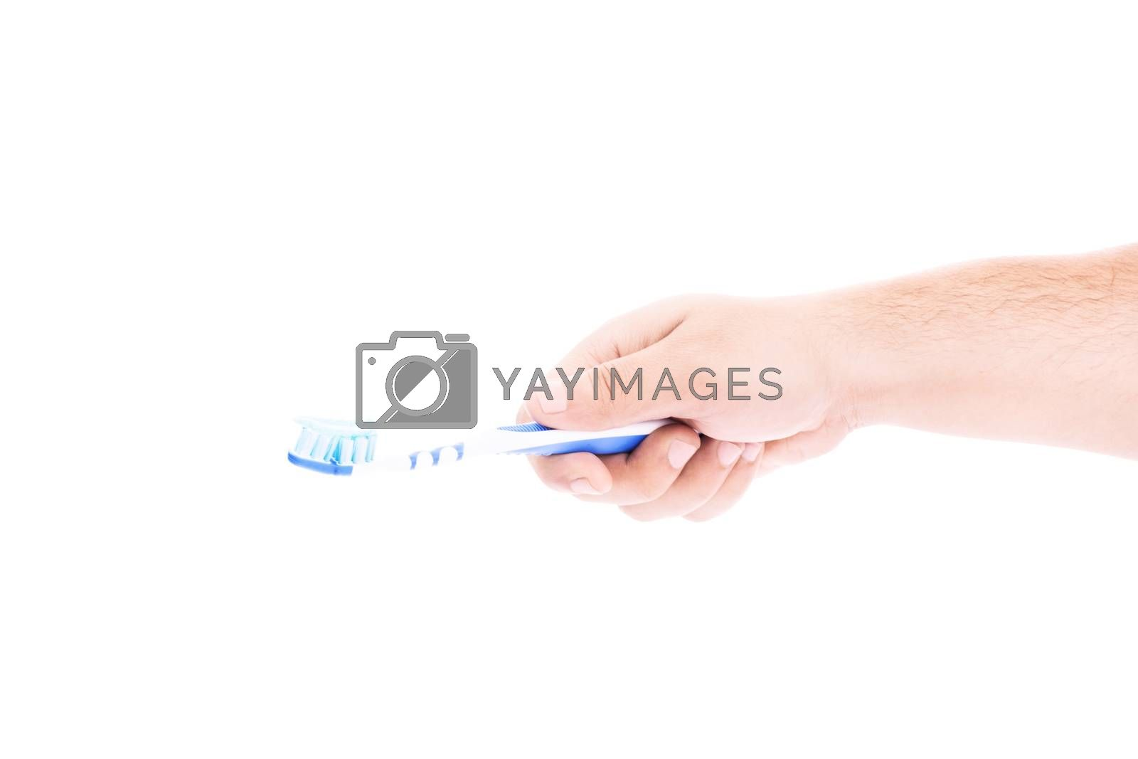 Close-up shot of a male hand holding a toothbrush with paste on it, isolated on white background.