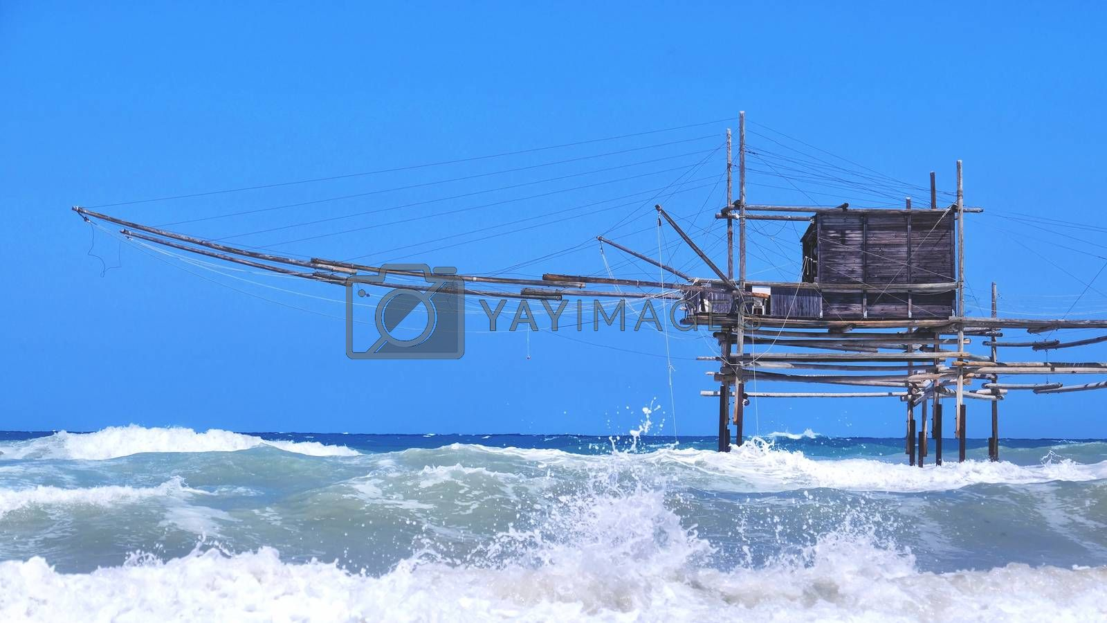 Trabocchi coast in Abruzzo with big waves on rough sea - Italy - a trabucco is an old fishing machines famous in south italy sea .