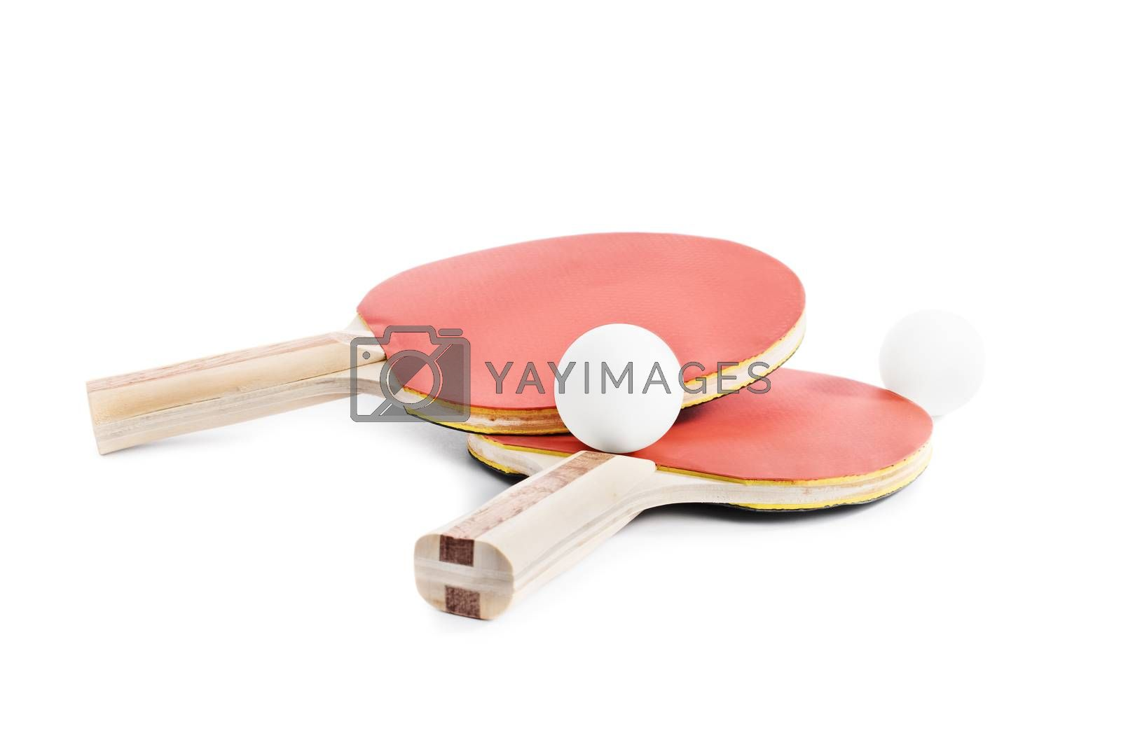 Close up shot of ping-pong bats with two balls, isolated on white background.