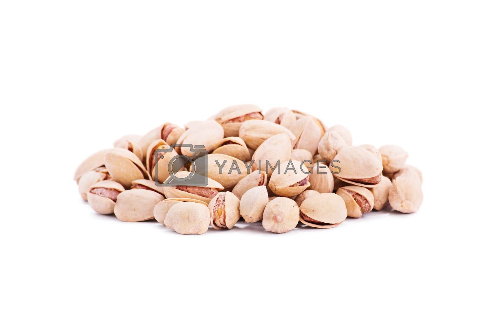 Close up shot of heap of pistachios, isolated on white background.