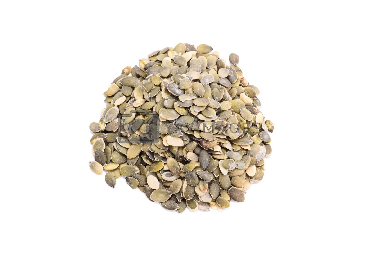 Top perspective of a heap of pumpkin seeds, isolated on white background.