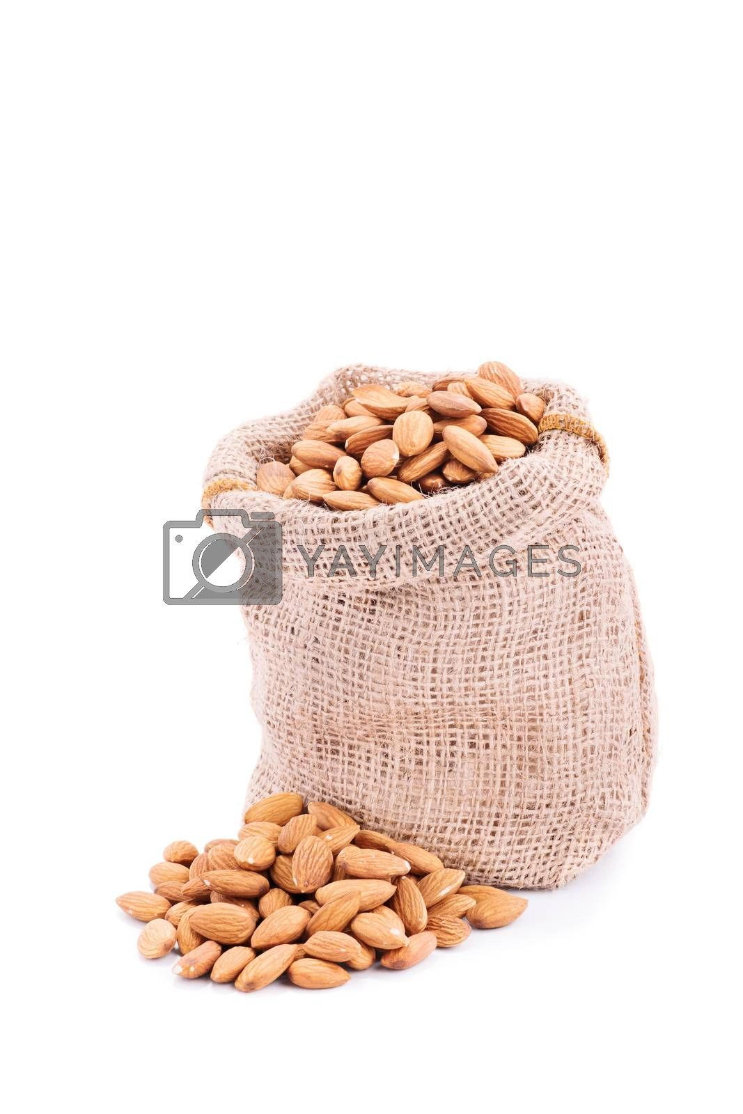 Close up shot of a small burlap sack of fresh almonds, isolated on white background.