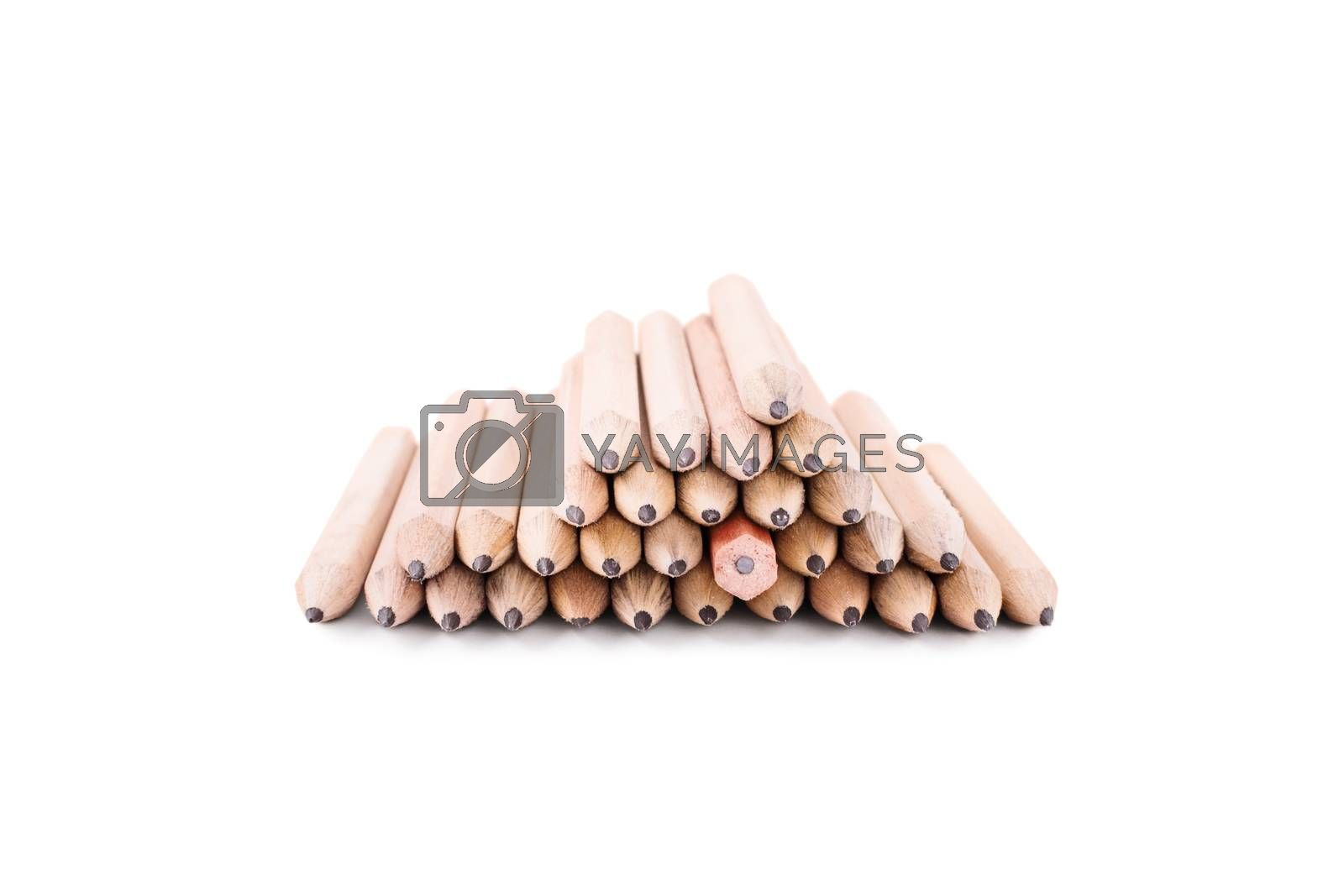 One makes a difference. Stack of pencils isolated on white background. One crayon among many pencils, turned in different direction.
