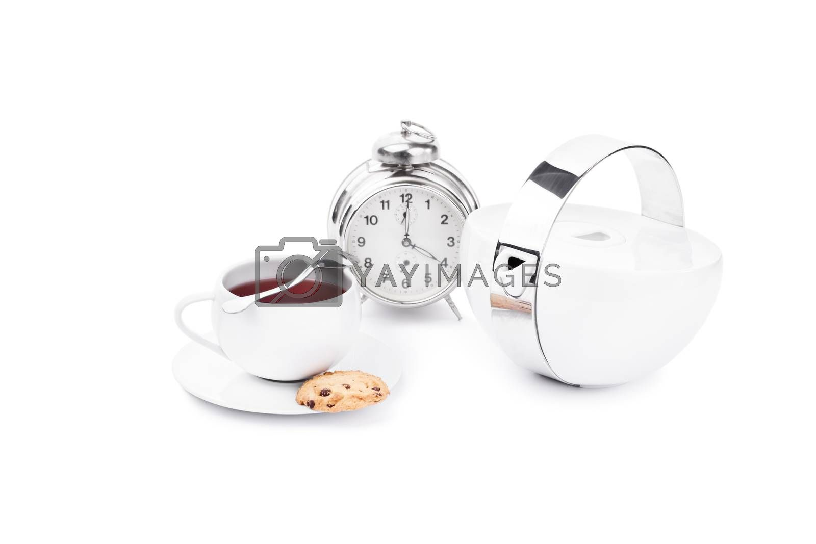 Cup of tea with chocolate cookies and an alarm clock,isolated on white background.