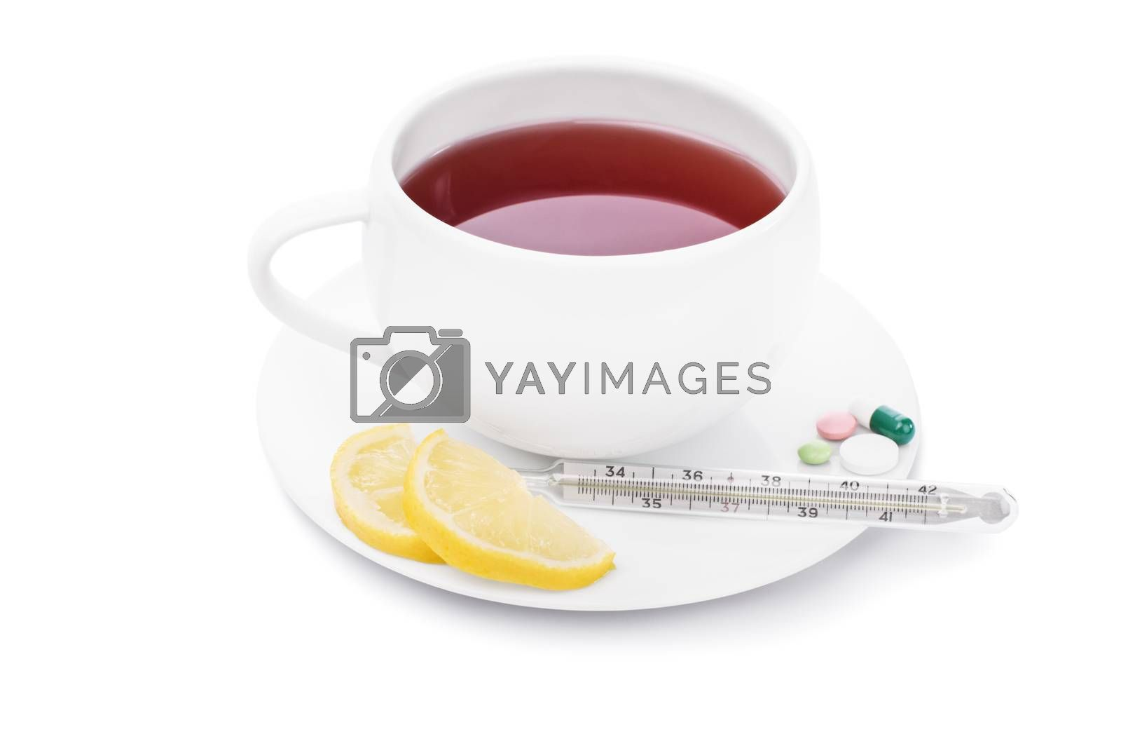 Tea with lemon, pills and thermometer, isolated on white background.