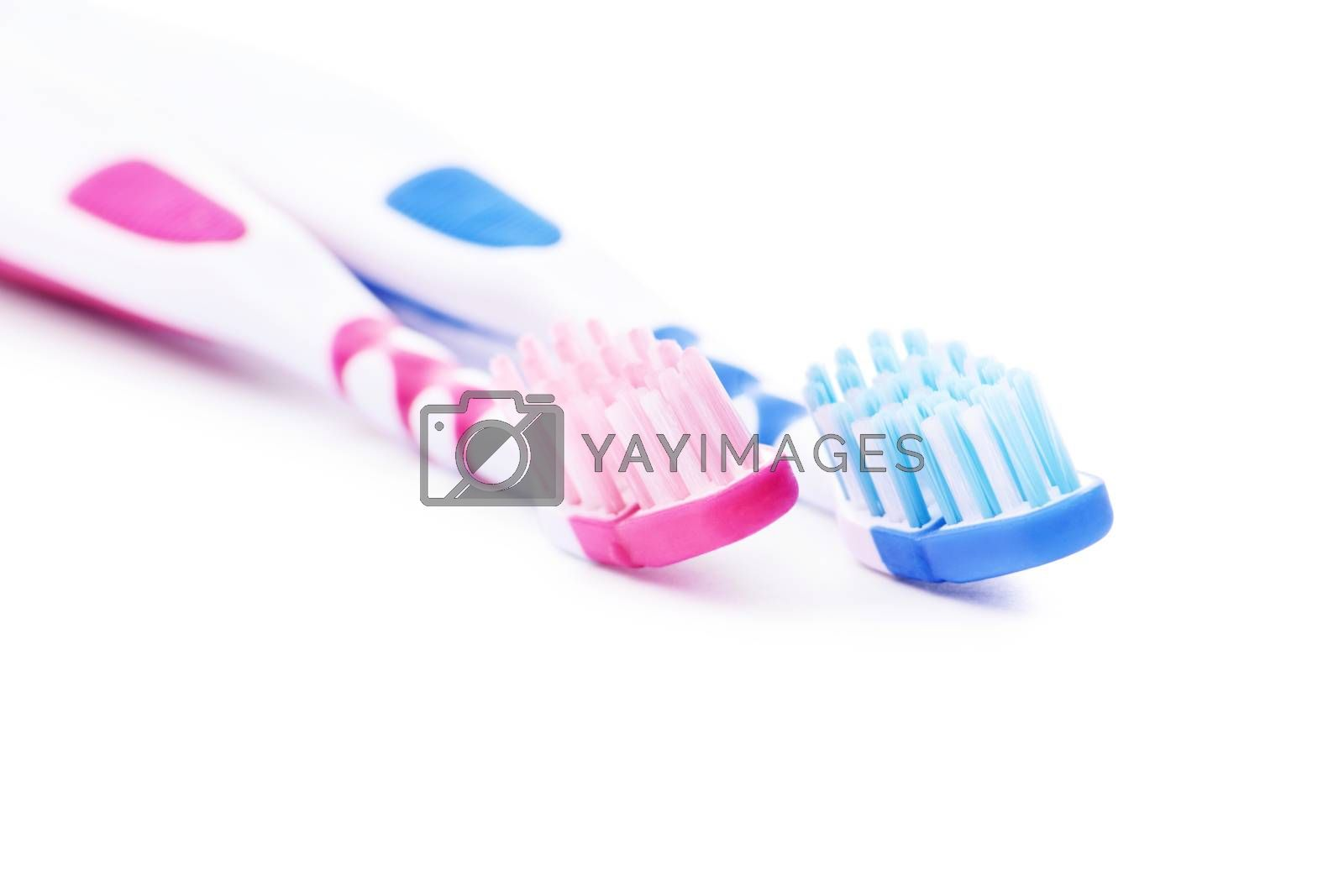 Set of toothbrushes, for him and her, isolated on white background.