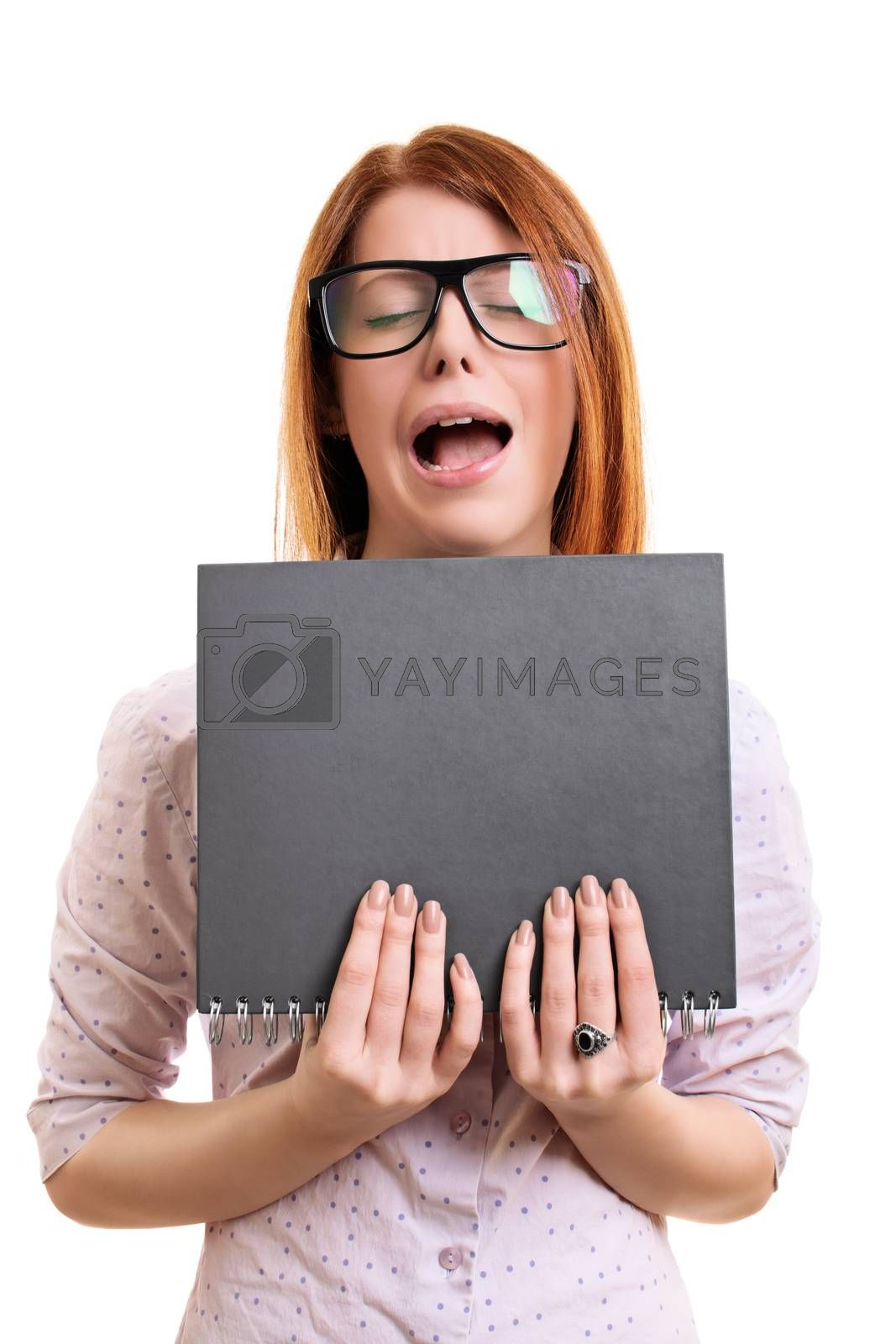 Nerdy young woman with tick glasses with an annoyed and frustrated expression holing a notebook, isolated on white background.