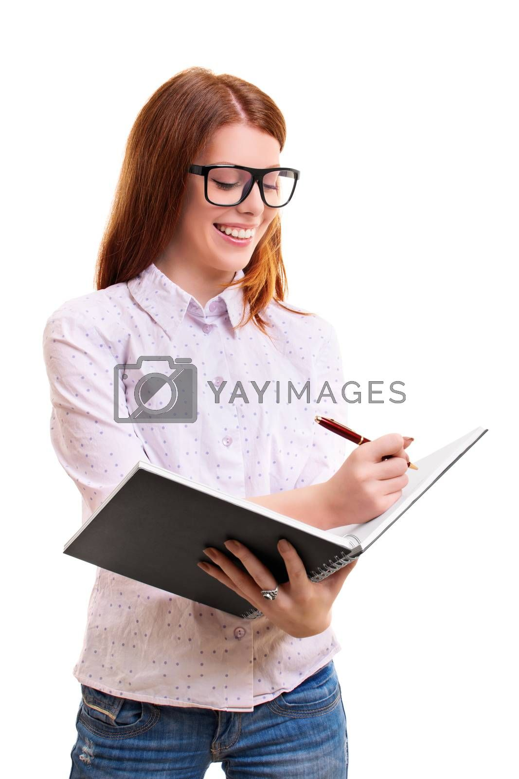 beautiful smiling young woman holding a notebook and taking notes, isolated on white background
