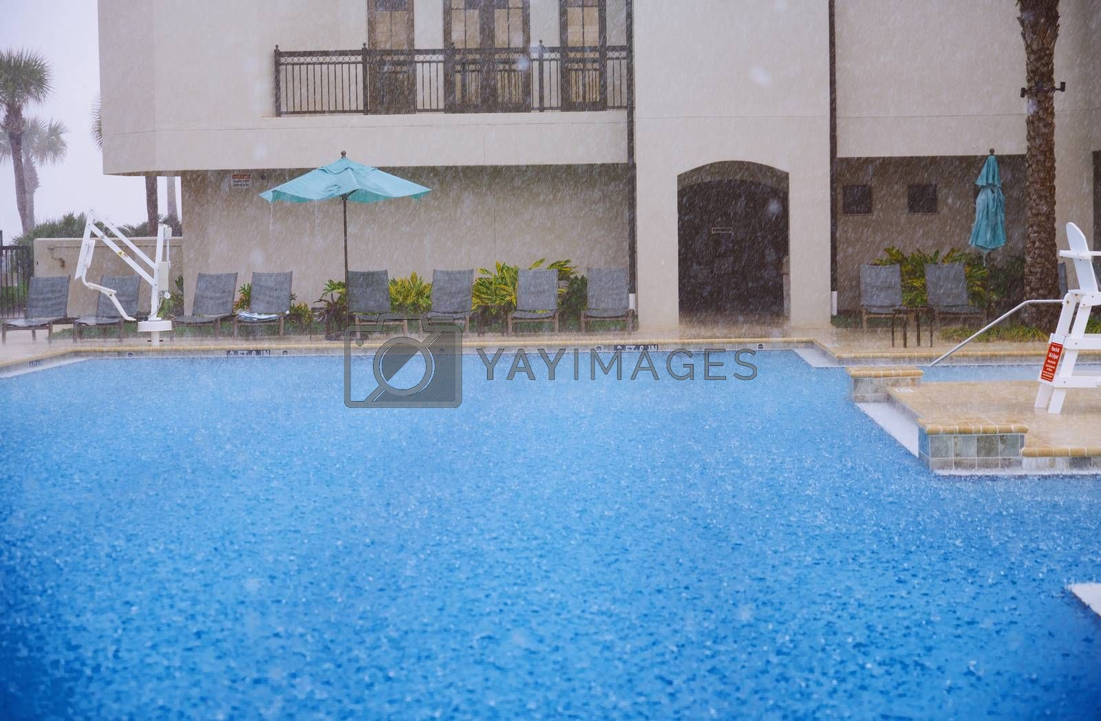 Outdoors swimming pool under the heavy rain