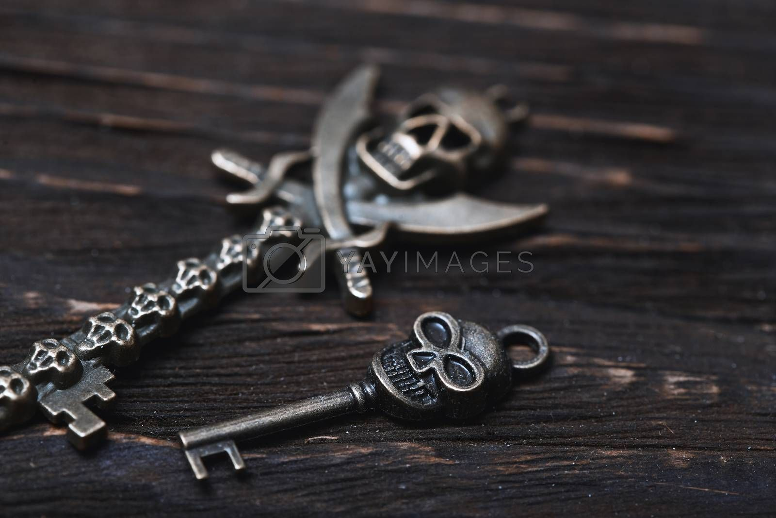Vintage skull skeleton keys on a wooden table by Novic