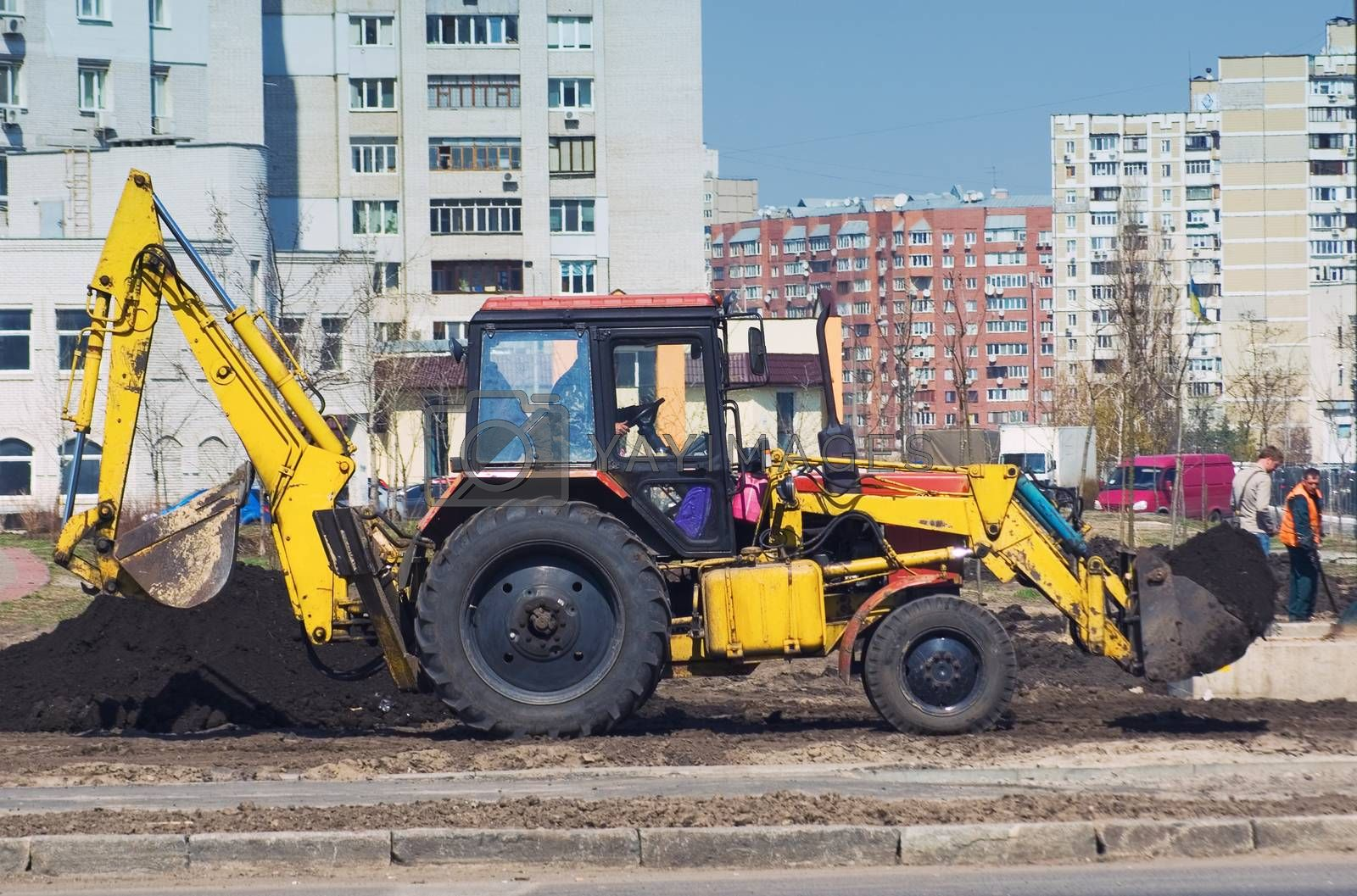 tractor working on urban street improvement