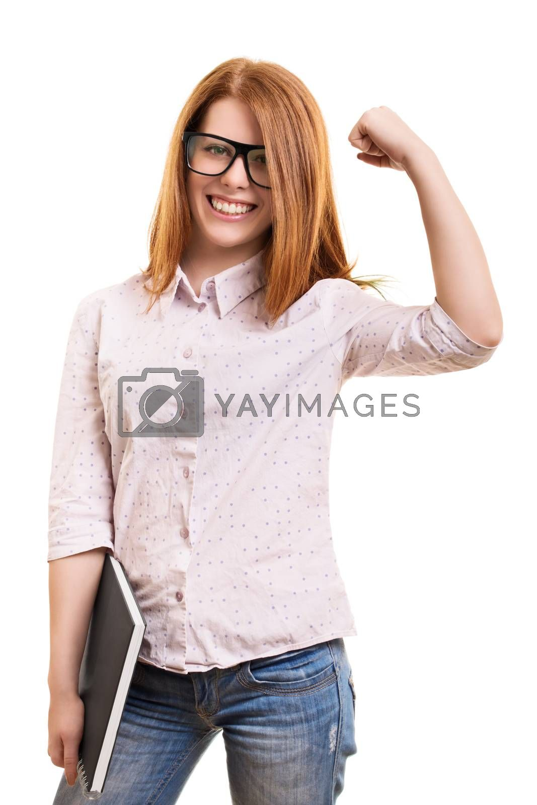 A portrait of a beautiful smiling girl with glasses, holding a book and cheering because of passed exams, isolated on a white background.
