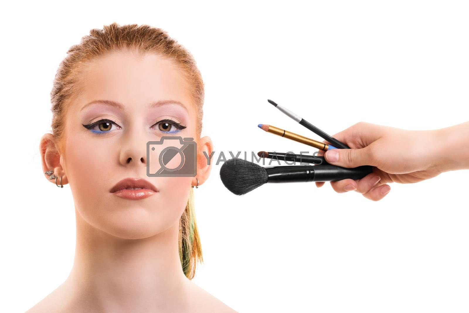 Beautiful girl getting her make up by Mendelex