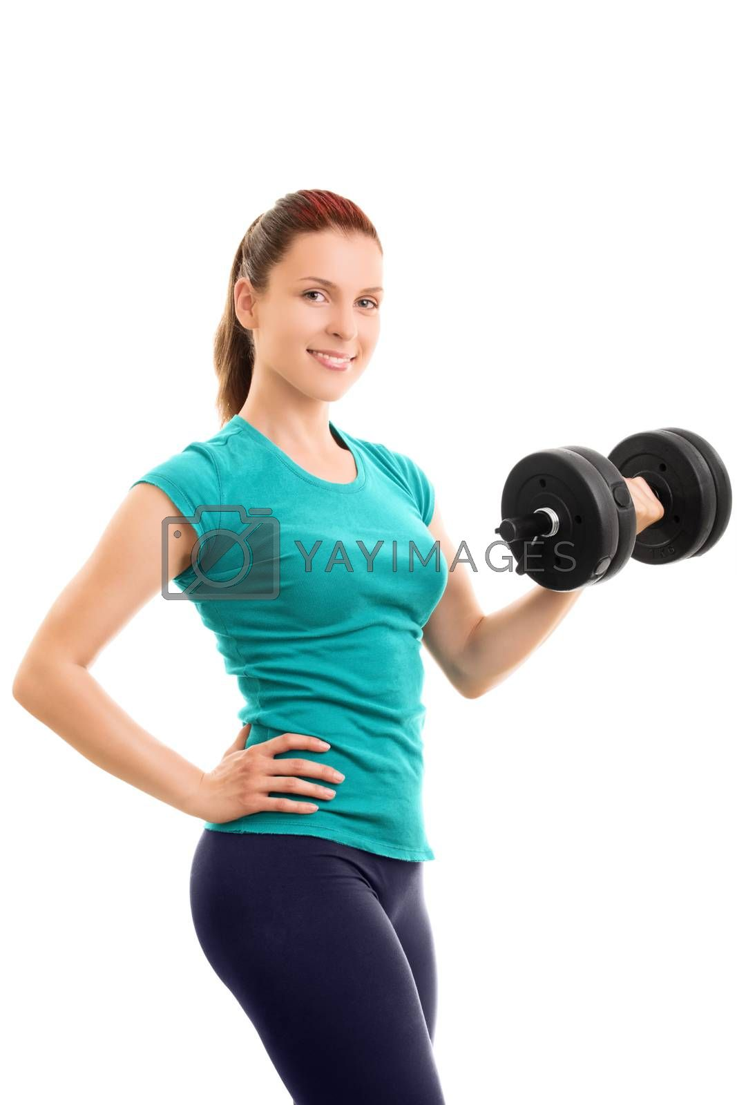A portrait of a beautiful fit young girl holding a dumbbell, isolated on white background. Beautiful fit young girl lifting a dumbbell, isolated on a white background.