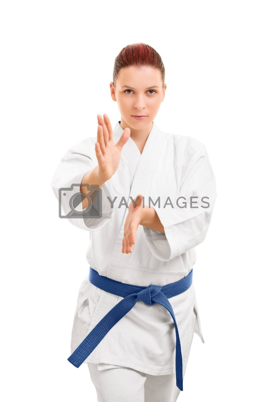 A portrait of a beautiful young girl in a kimono, standing in a combat stance, isolated on white background.