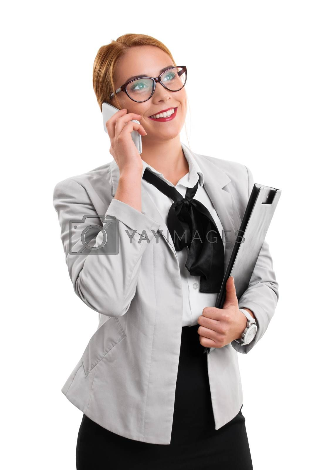 A portrait of a businesswoman talking on the phone, holding a notepad, isolated on white background.