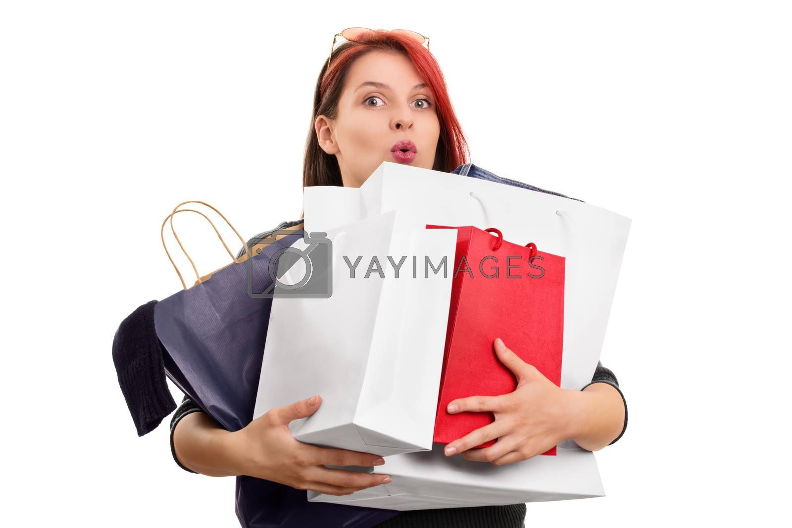 Excited young girl with shopping bags by Mendelex