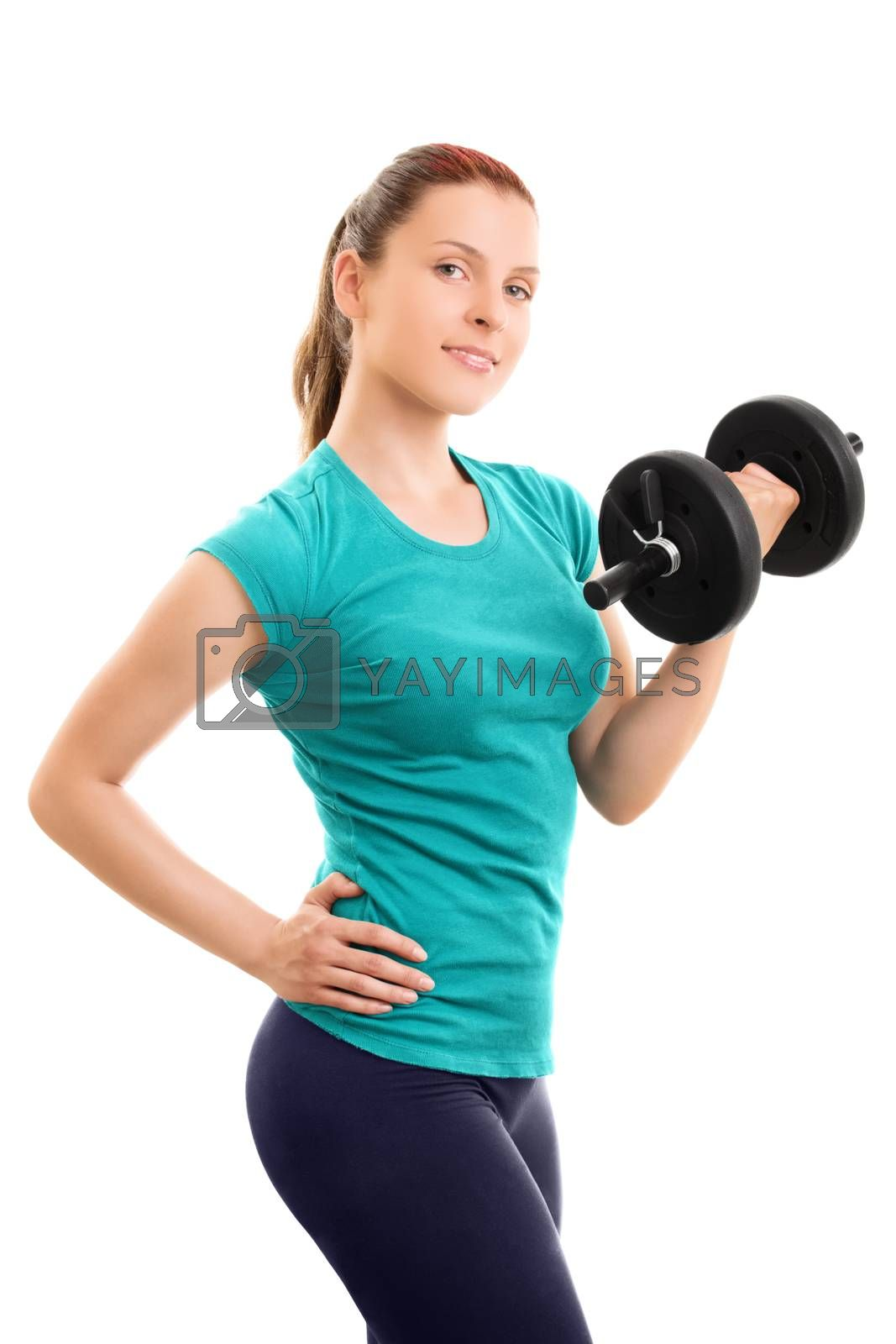A portrait of a beautiful fit young girl holding a dumbbell, isolated on white background.