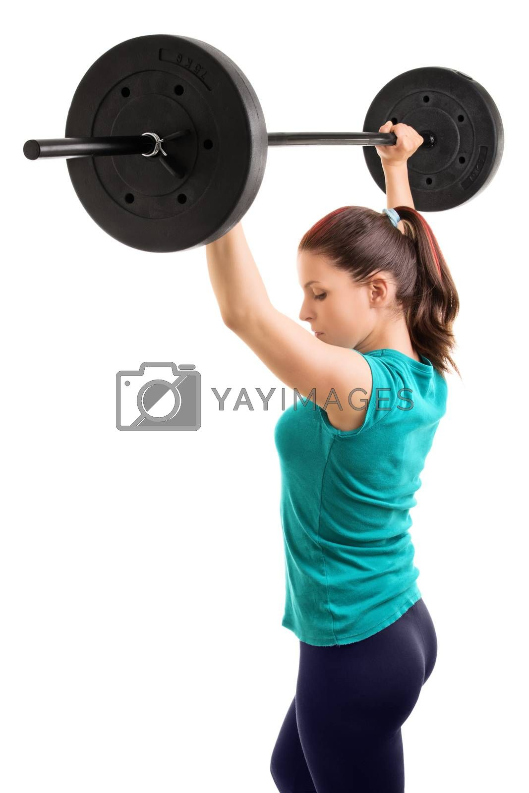 And hold! Young girl athlete holding a barbell up, isolated on white background.