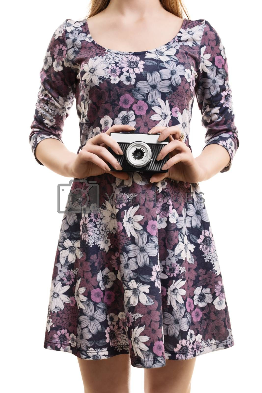 A close up shot of a girl in a colorful dress, hodling a vintage camera, isolated on white background.